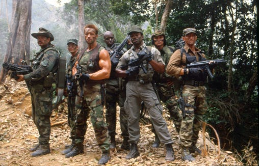 "The ""Predator"" lineup back in the day: Jesse Ventura (far left), Shane Black, Arnold Schwarzenegger, Bill Duke, Carl Weathers, Sonny Landham and Richard Chaves."