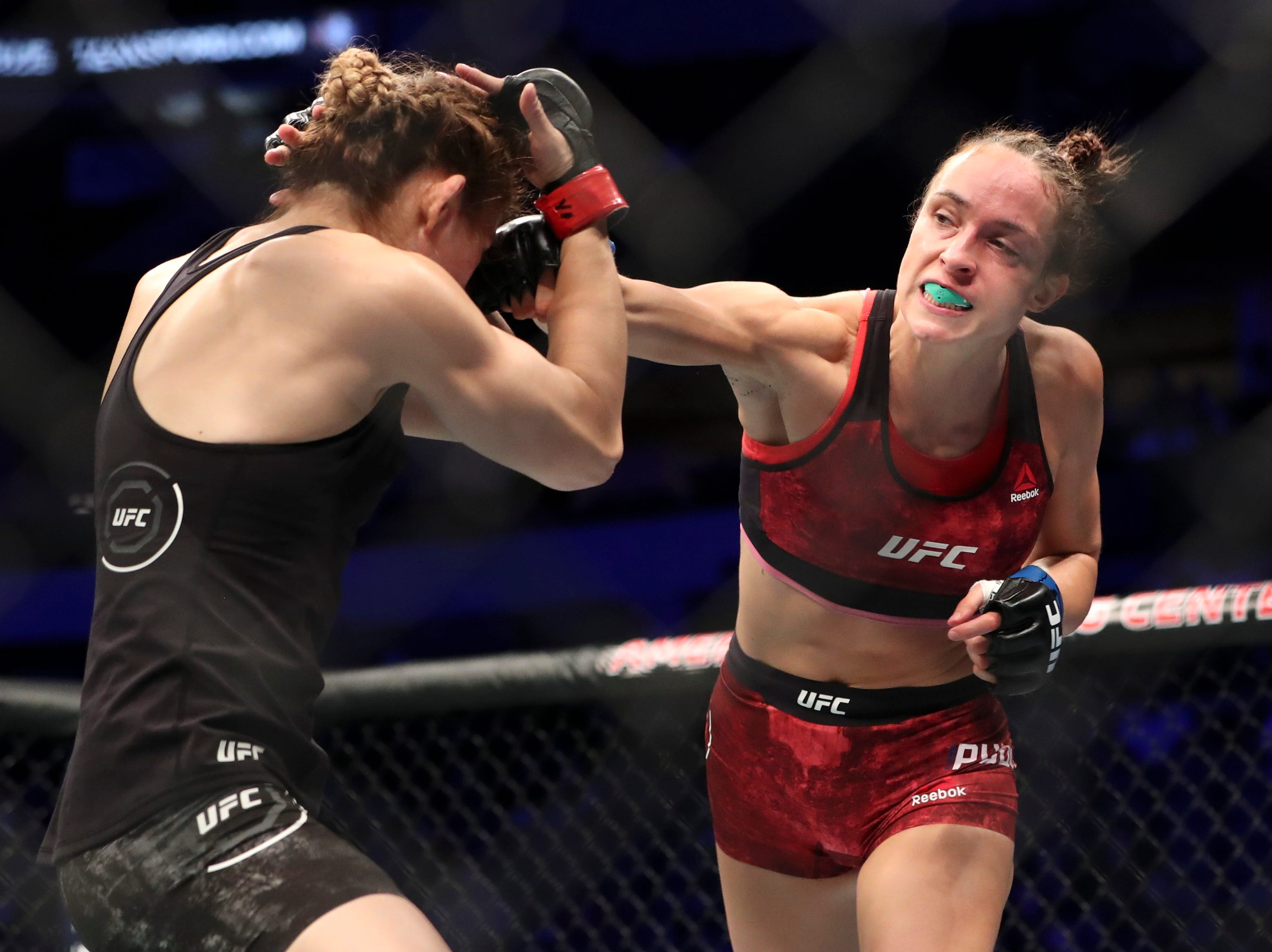 Irene Aldana (red gloves) fights Lucie Pudilova (blue gloves) during UFC 228 at American Airlines Center.