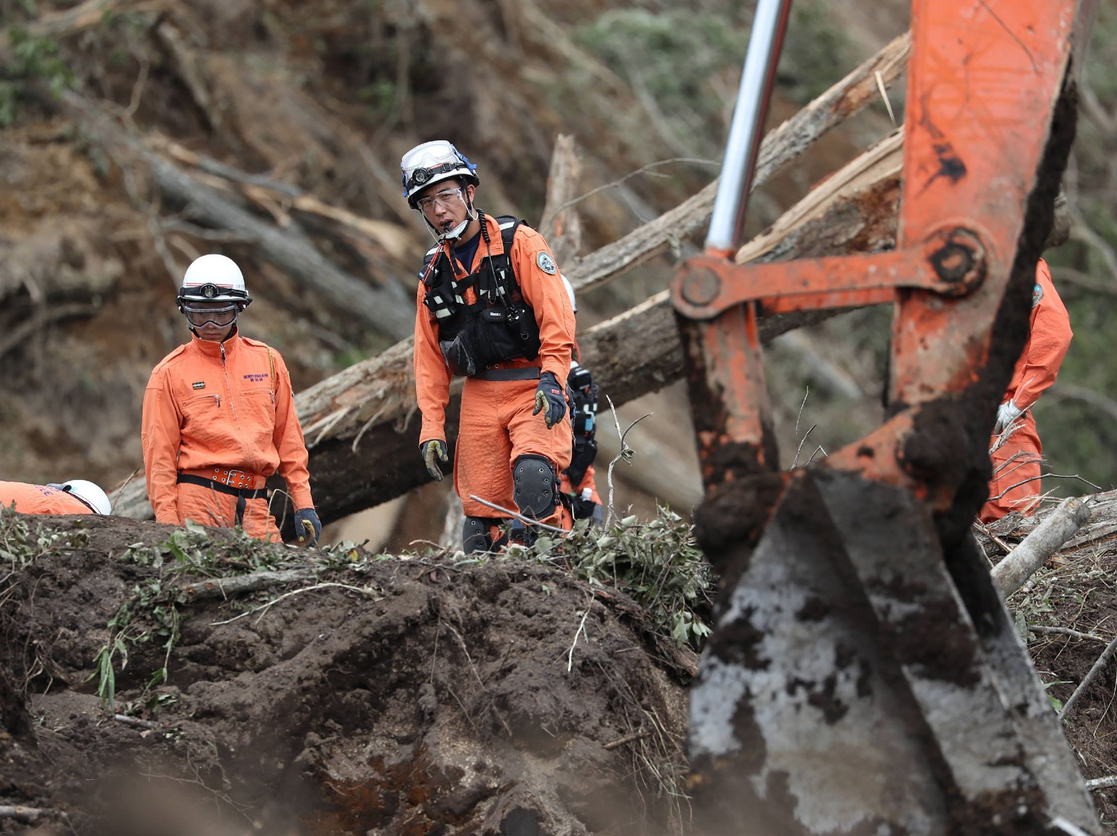 Rescue teams from fire fighter department search for missing people in Astuma on Sept. 8, 2018 after a 6.6-magnitude earthquake hit the northern Japanese island of Hokkaido on September 6.