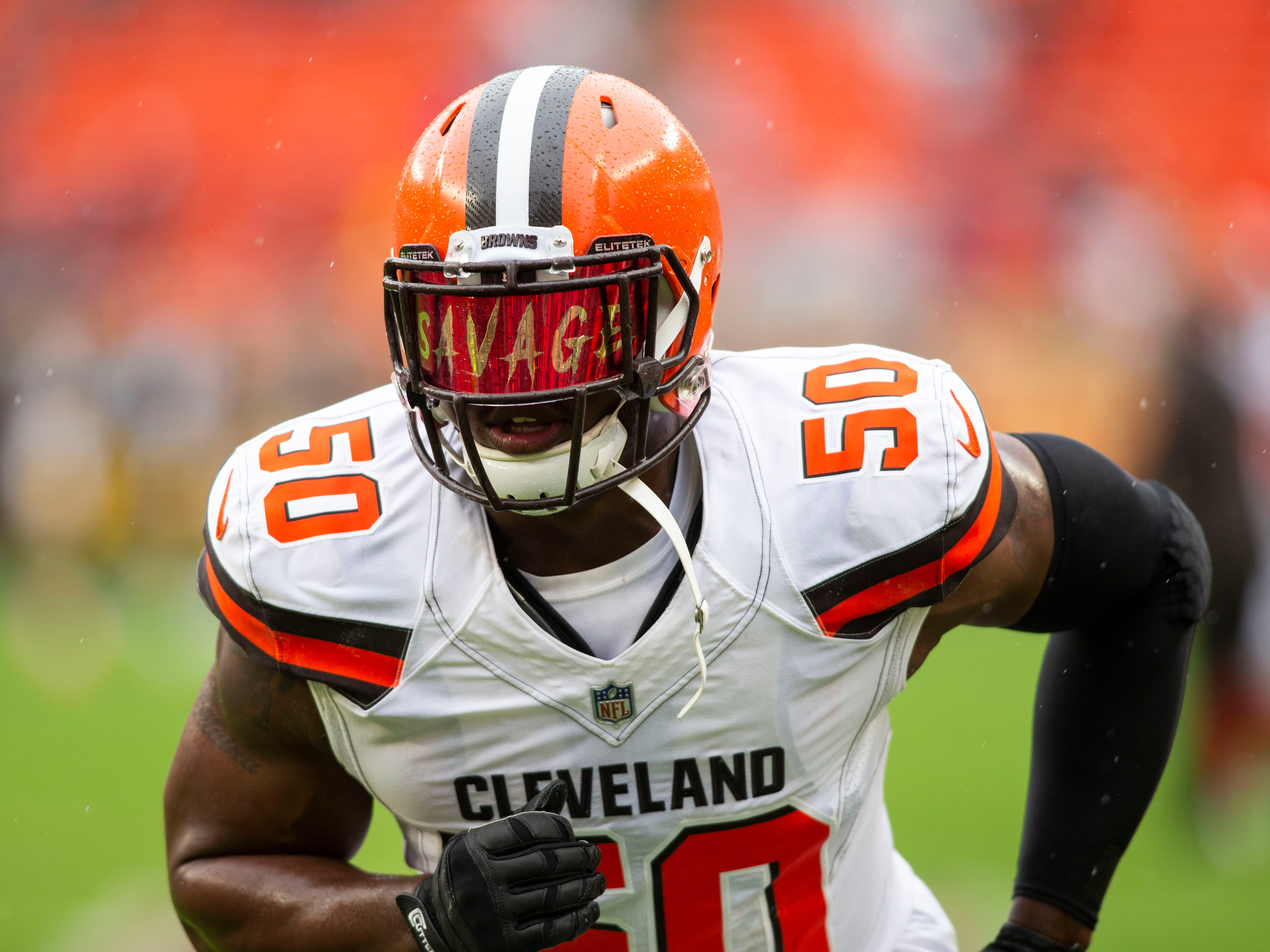Cleveland Browns defensive end Chris Smith runs during warmups before the game against the Pittsburgh Steelers at FirstEnergy Stadium.