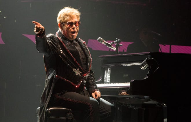 Elton John strikes a pose.