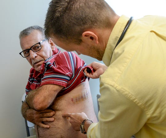 Dr. Chet Walters conducts a checkup of patient Kim Edward Vaughn of Anderson. Vaughn was stunned when he learned he had a spot on his lung, but recent surgery removed the cancer when it was still in its early stages.