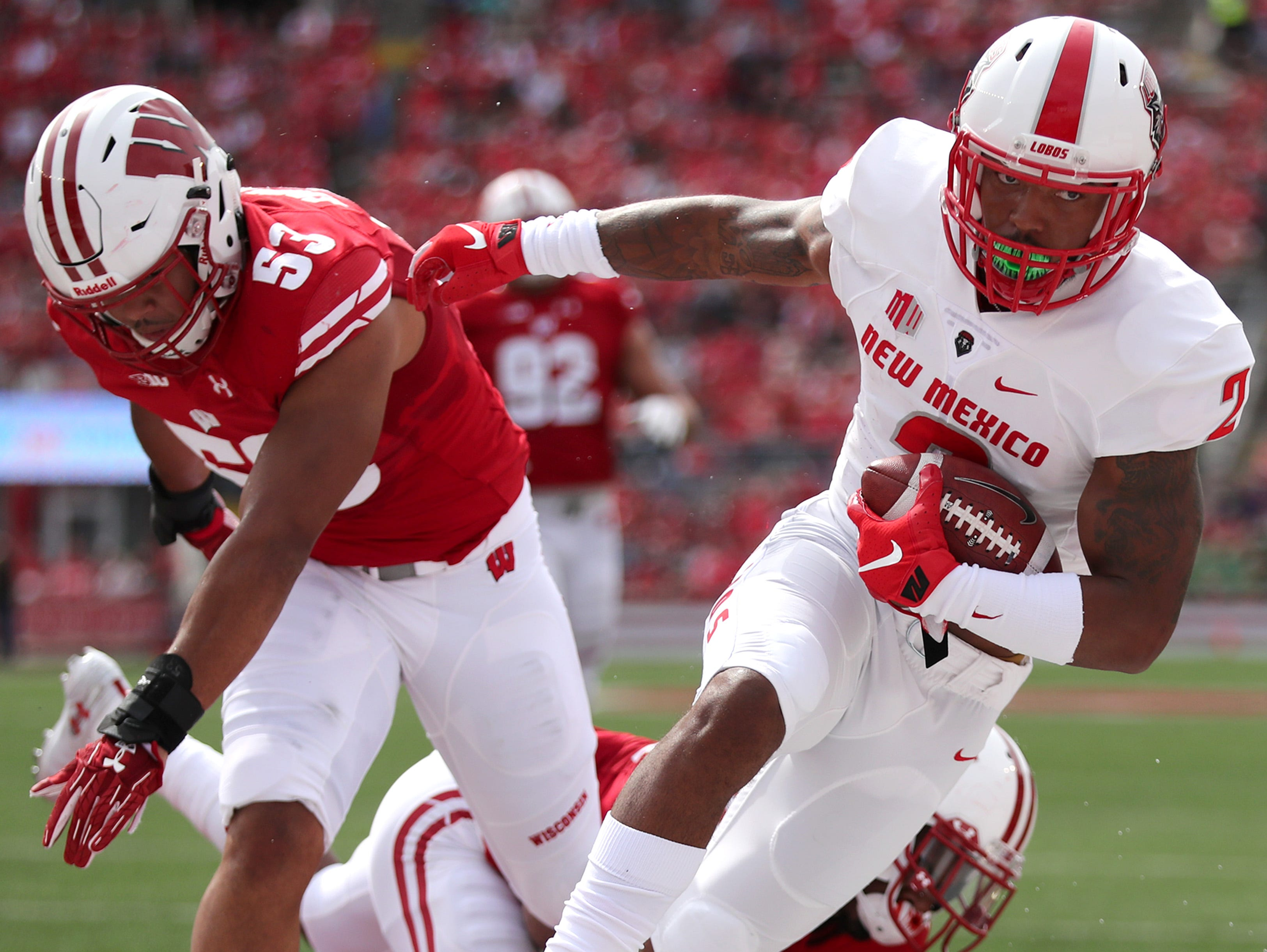 New Mexico wide receiver Delane Hart-Johnson (2) breaks through tackles from Wisconsin linebacker T.J. Edwards (53) and Wisconsin cornerback Faion Hicks (20) for a touchdown Saturday, Sept. 8, 2018, at Camp Randall Stadium in Madison, Wis.