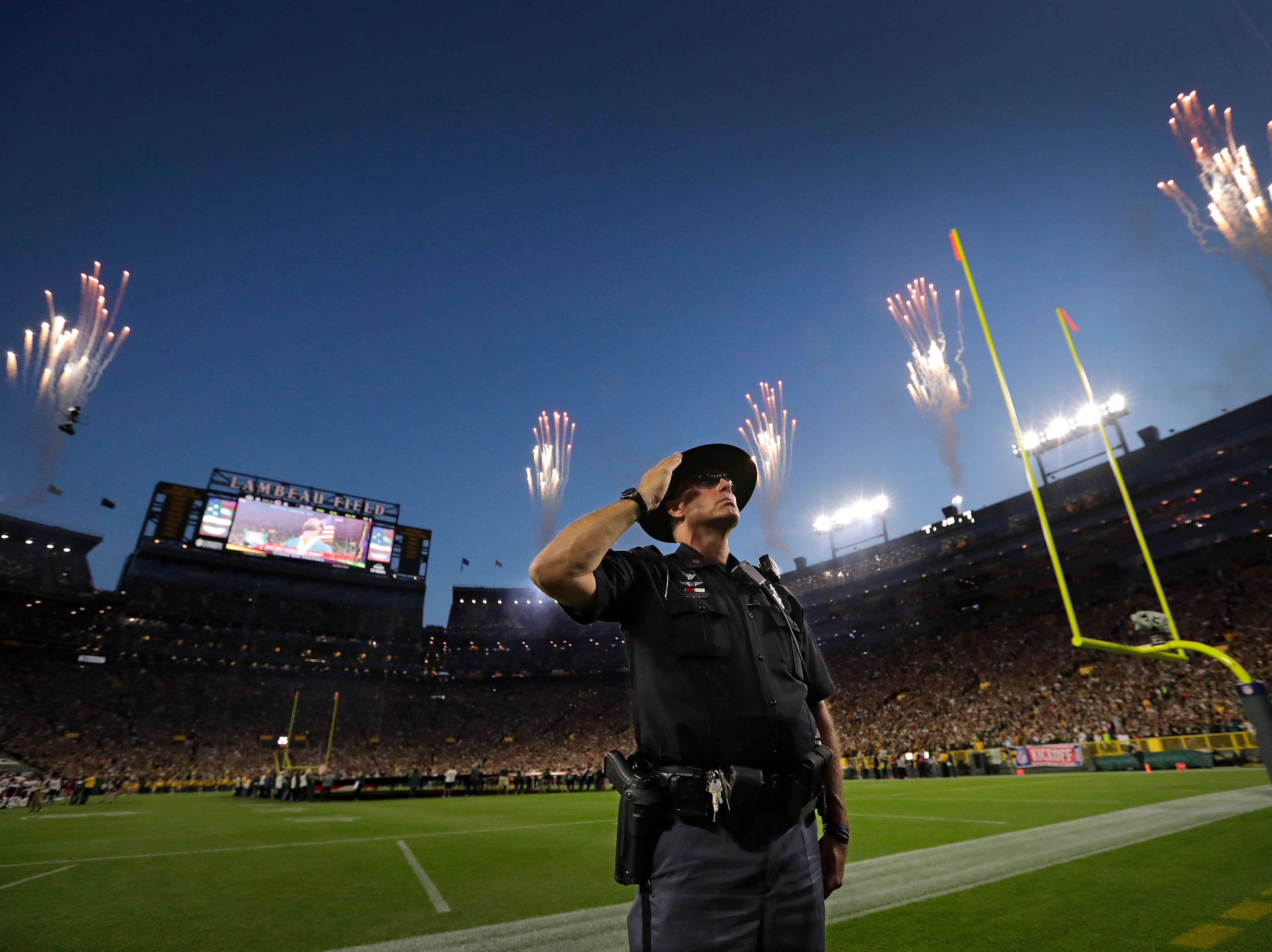 Wisconsin State Patrol trooper John Jones salutes during the national anthem before the Green Bay Packers play the Chicago Bears Sunday, Sept. 9, 2018, at Lambeau Field in Green Bay, Wis. 