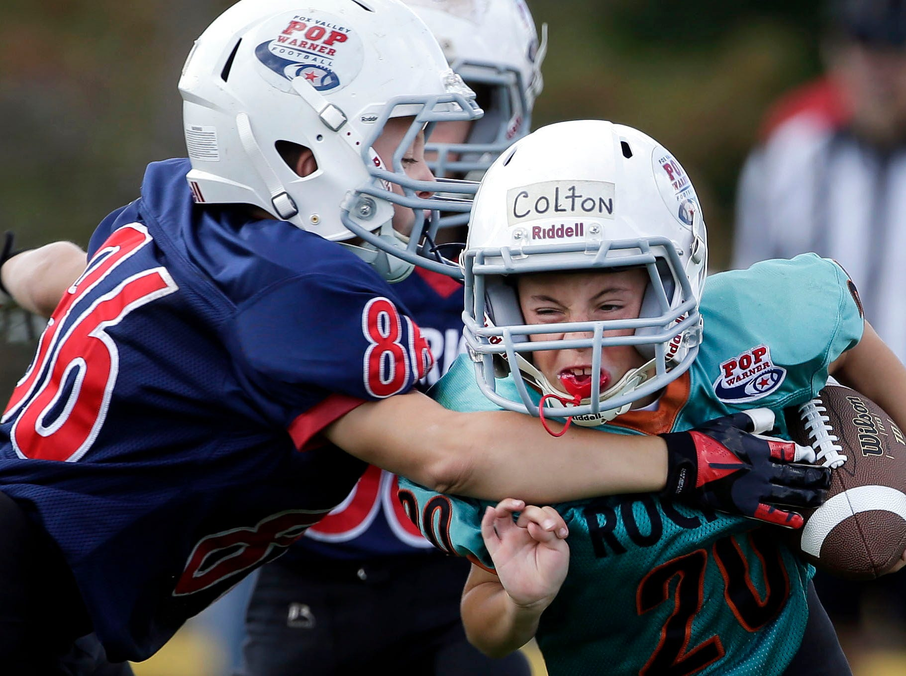 Colton Kreger of the Rockets carries the ball against the Patriots in the Junior Pee Wee Division as Fox Valley Pop Warner Football opens the season Saturday, September 8, 2018, at Plamann Park in Grand Chute, Wis.