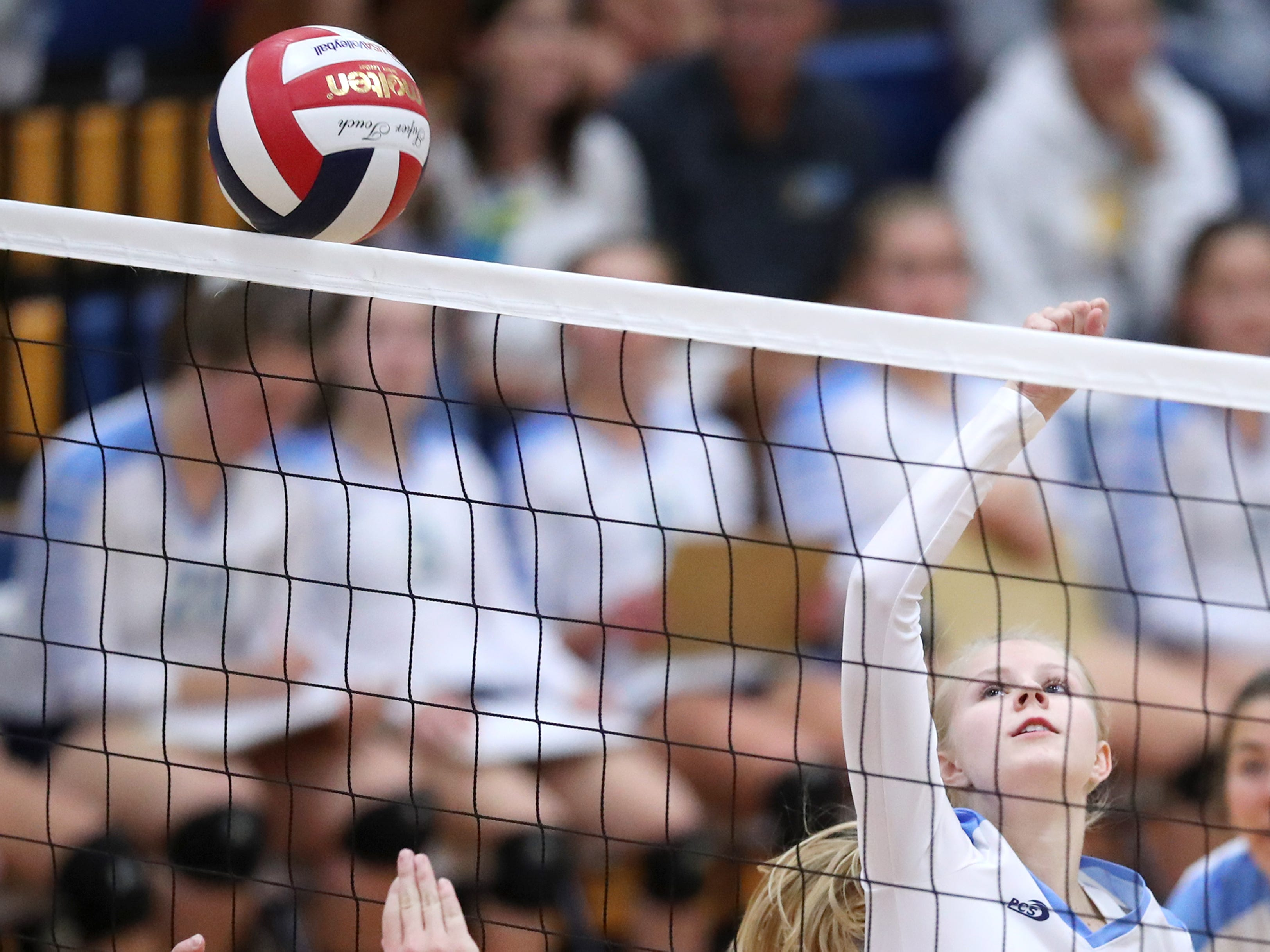 St. Mary Catholic's Katie Olson tips the ball over the net against Mishicot Thursday, Sept. 6, 2018, in Fox Crossing, Wis.