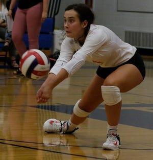 Kimberly's Lauren Elliott digs the ball against Oshkosh West during a Fox Valley Association match Sept. 6 in Oshkosh.