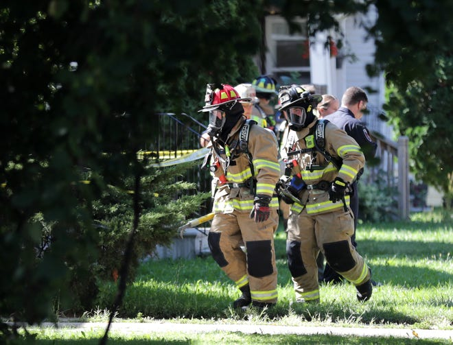 Firefighters and police on the scene of a structure fire in the 100 block of First Street,  on Thursday, September 6, 2018, in Menasha, Wis.  Kevin Kloehn, chief of Neenah-Menasha Fire Rescue, said one person was injured and three others were rescued in the fire.Wm. Glasheen/USA TODAY  NETWORKWisconsin
