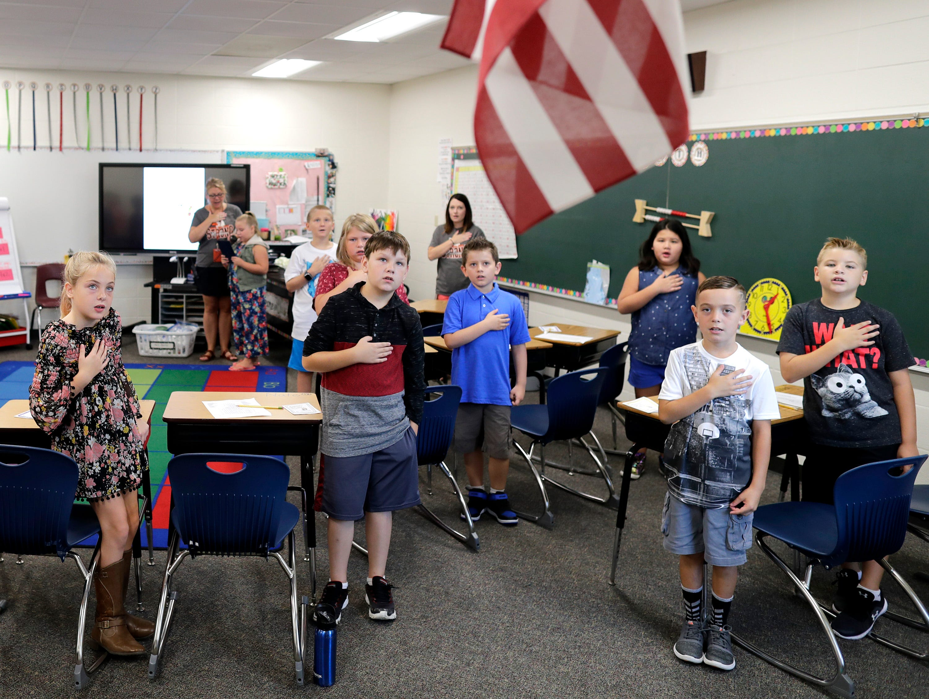 Students say the Pledge of Allegiance of return to class on the first day of school at Victor Haen Elementary on Tuesday, September 4, 2018, in Kaukauna, Wis. 