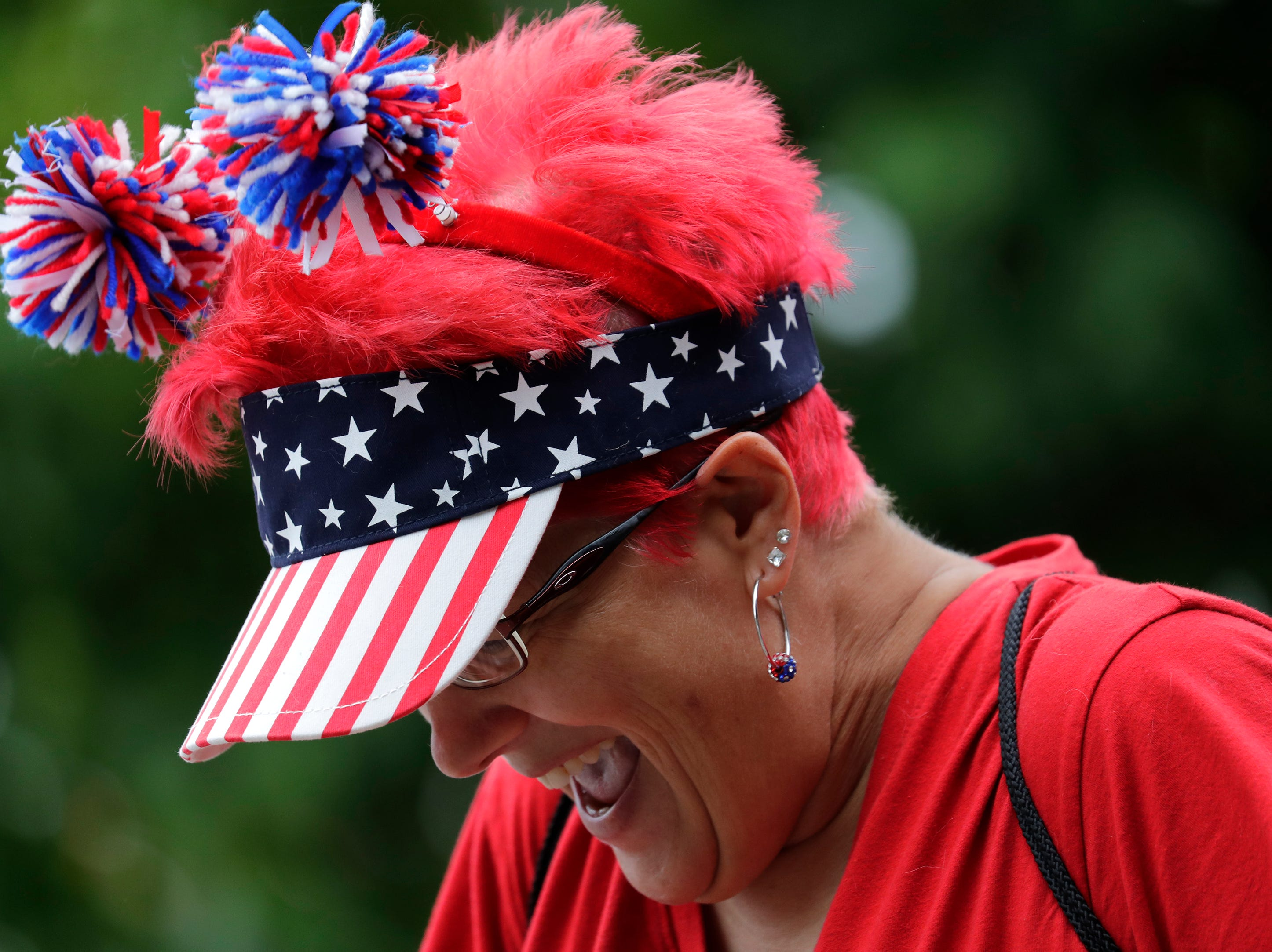 Amy Schneider of Wautoma participates in the Neenah-Menasha Labor Day Parade Monday, Sept. 3, 2018, in downtown Menasha, Wis. 