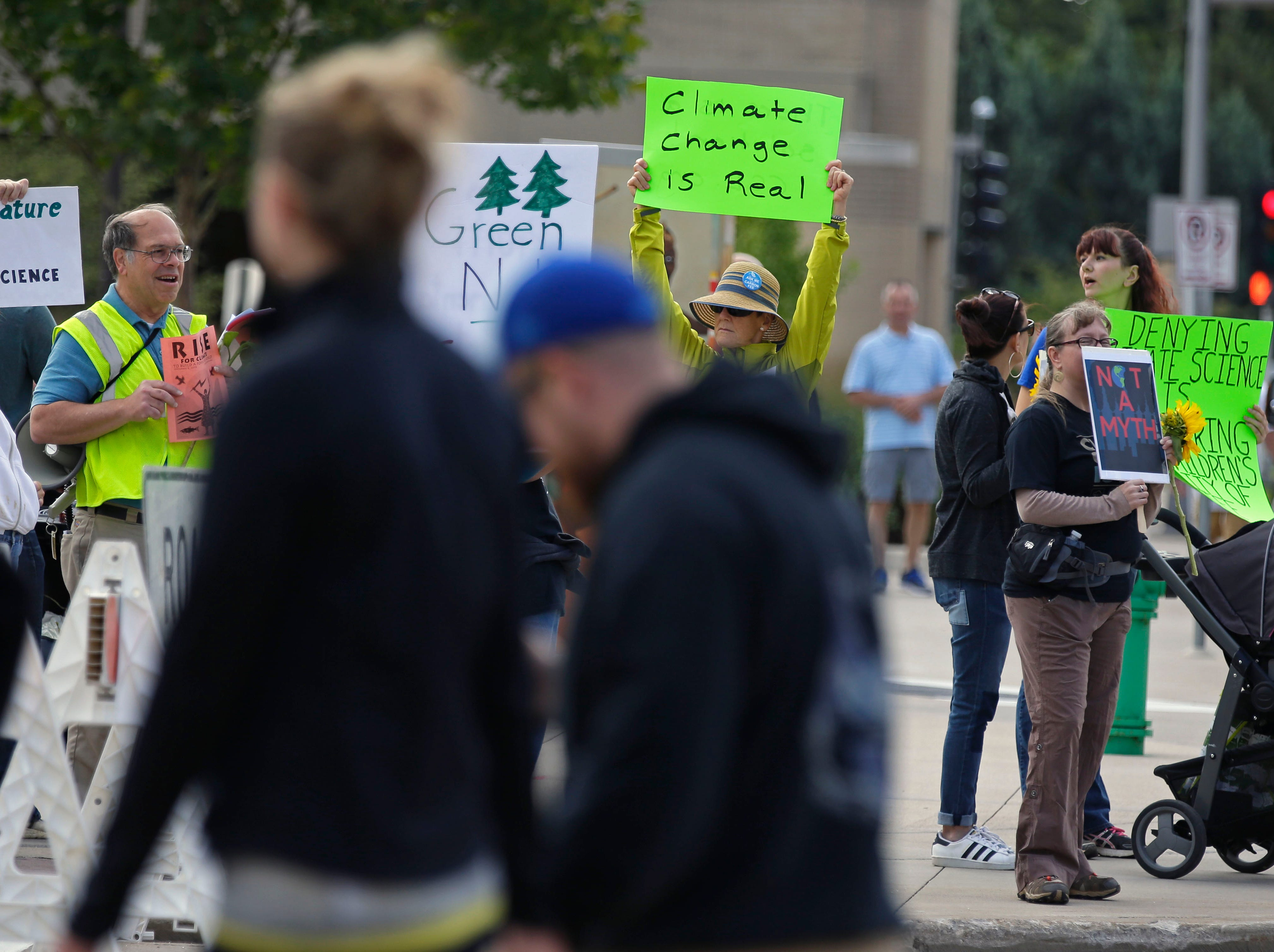 A rally for Rise for Climate takes place Saturday, September 8, 2018, in downtown Appleton, Wis. The event was in conjunction with gatherings around the world before the Global Climate Action Summit to be held next week in California.