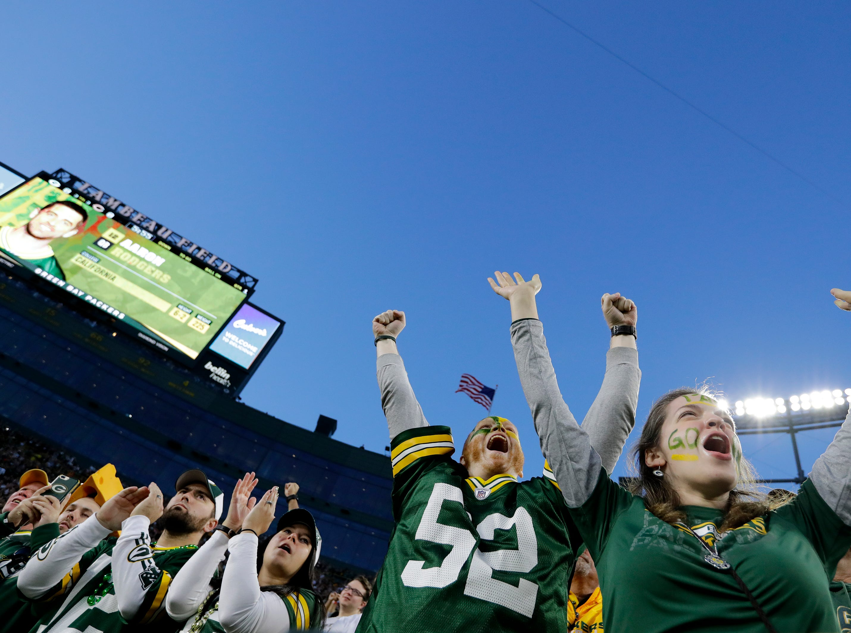 Green Bay Packers fans cheer for Aaron Rodgers as he is announced against the Chicago Bears Sunday, Sept. 9, 2018, at Lambeau Field in Green Bay, Wis. 