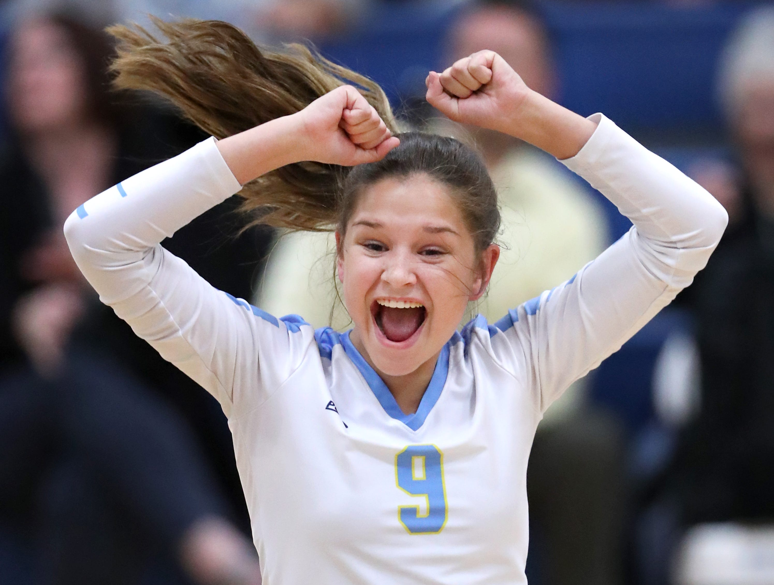Rosie Butler, of St. Mary Catholic, celebrates after scoring a point against Mishicot Thursday, Sept. 6, 2018, in Fox Crossing, Wis.