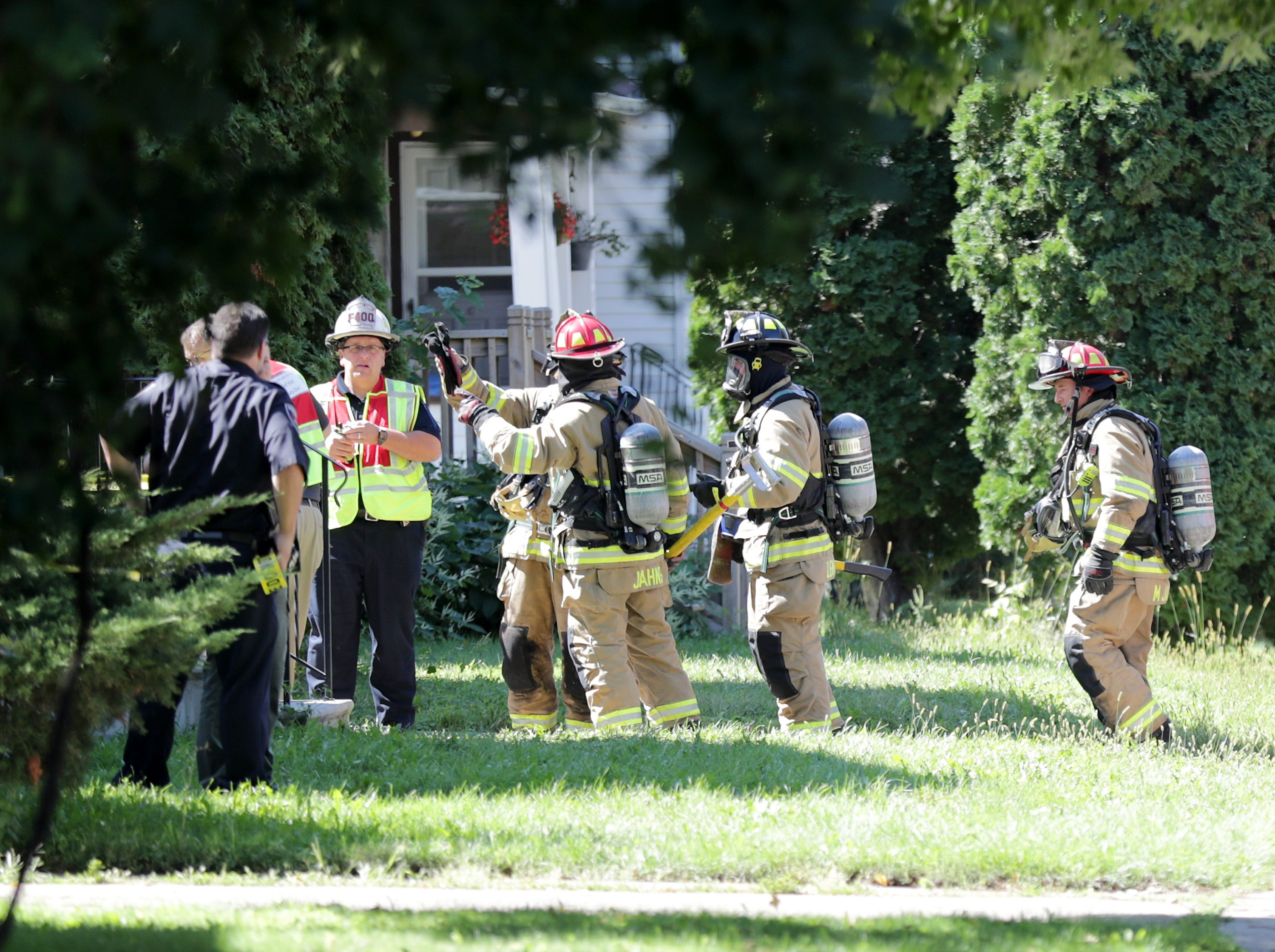 Firefighters and police on the scene of a structure fire in the 100 block of First Street,  