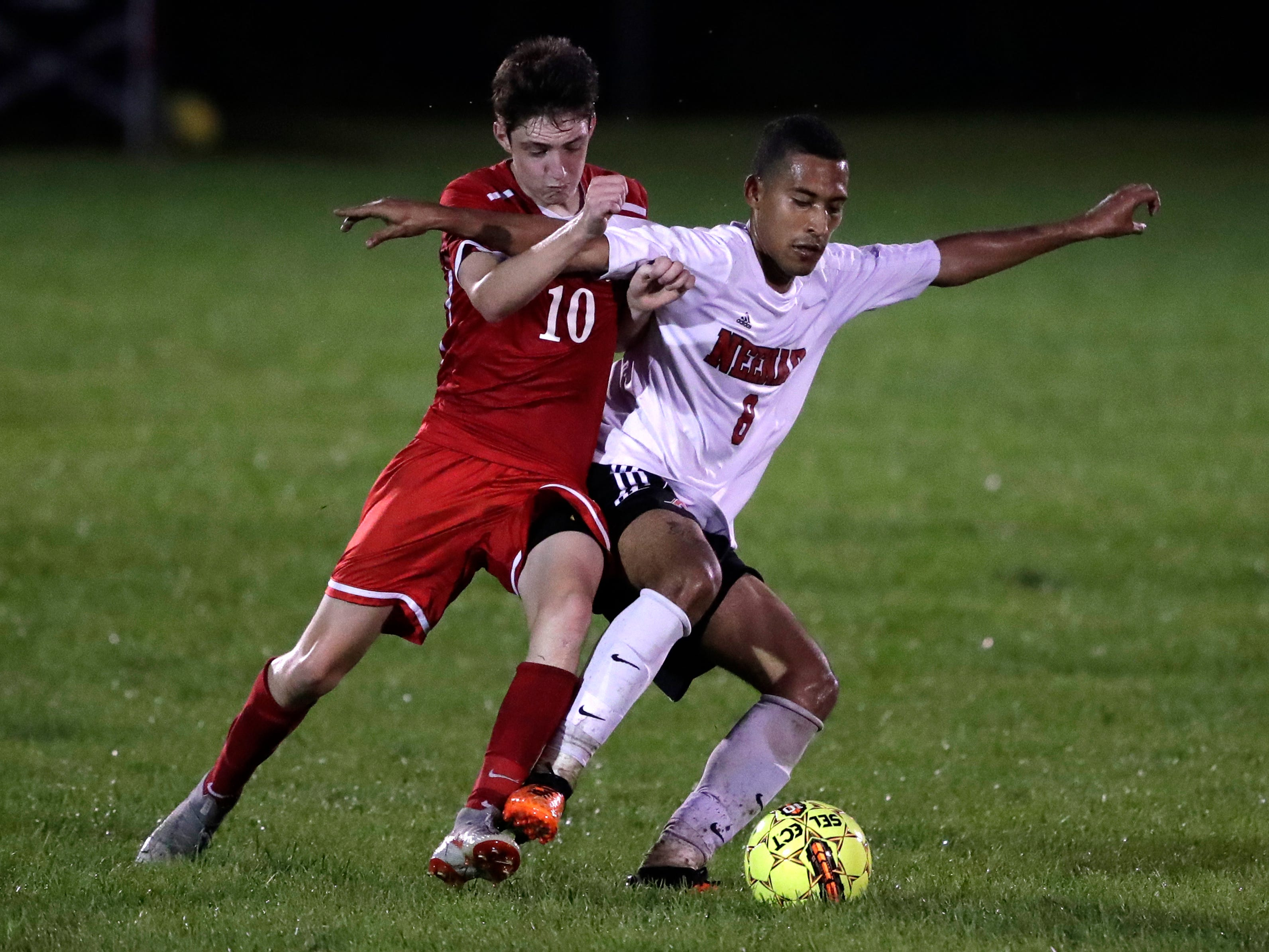 Kimberly High School's Dawson DeBoer (10) battles for possession of the ball against Neenah High School's Carlos Parra Polo (8) during their boys soccer game Tuesday, Sept. 4, 2018, at Papermaker Field in Kimberly, Wis. 