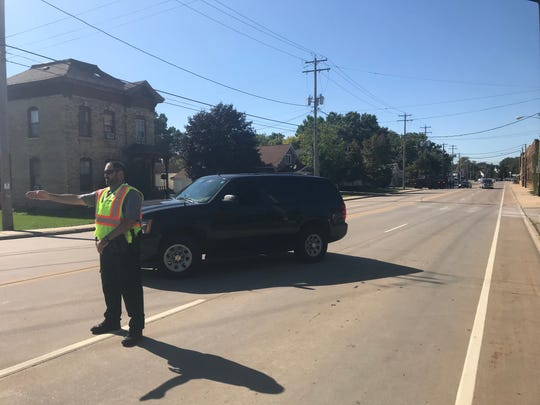 Traffic on Main Street in Neenah is blocked near Harrison Street.