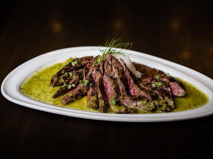 Churrasco with chimichurri at Caneda's White Rooster in Toms River.