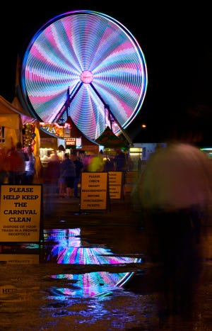 The lights of a Ferris wheel are blurred into a spiral pattern in this long exposure at the West Texas Fair & Rodeo last year. The final two days of the fair are Friday and Saturday.