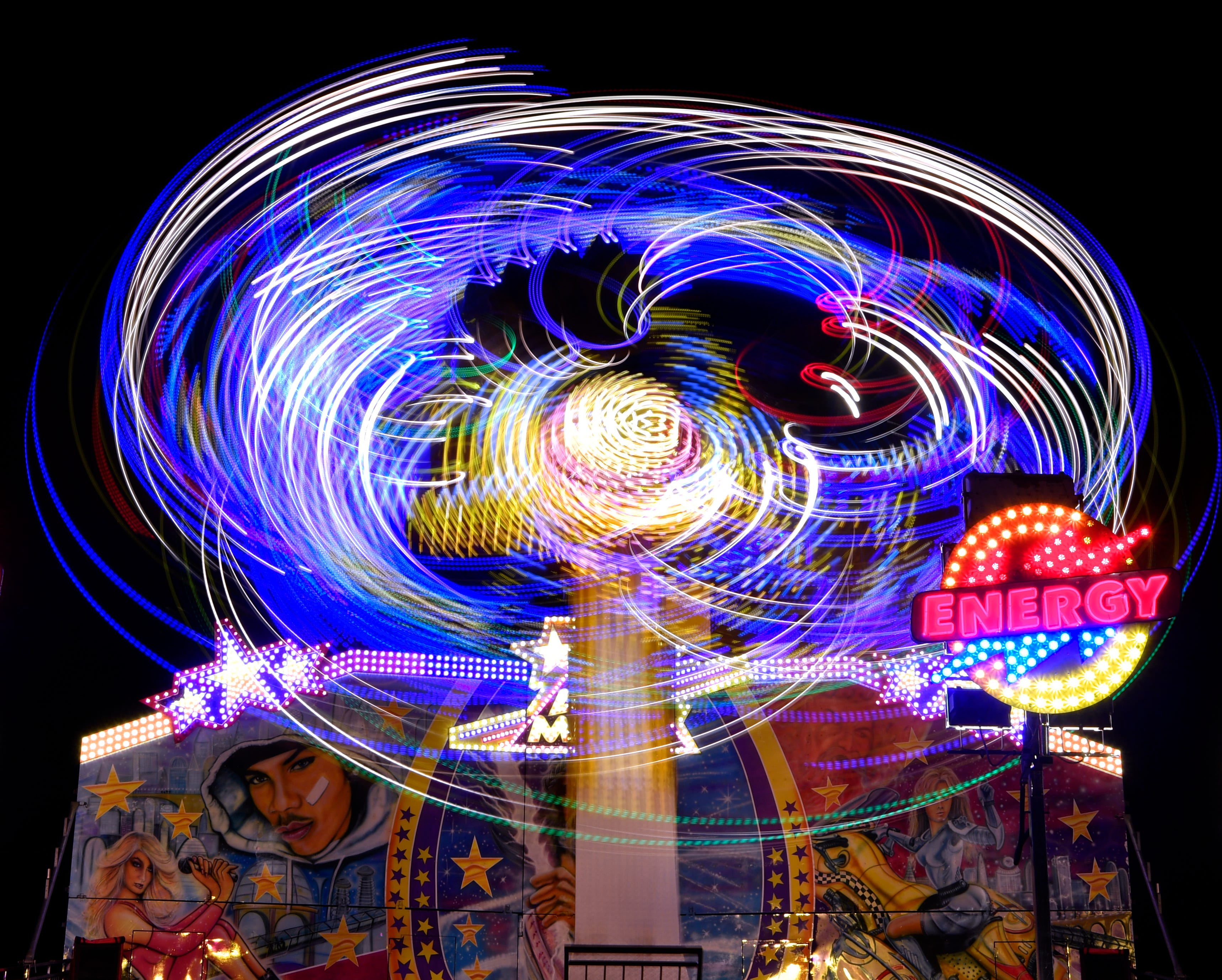 The lights of the Air Maxx at the West Texas Fair & Rodeo are blurred into a swirling pattern in this long exposure.