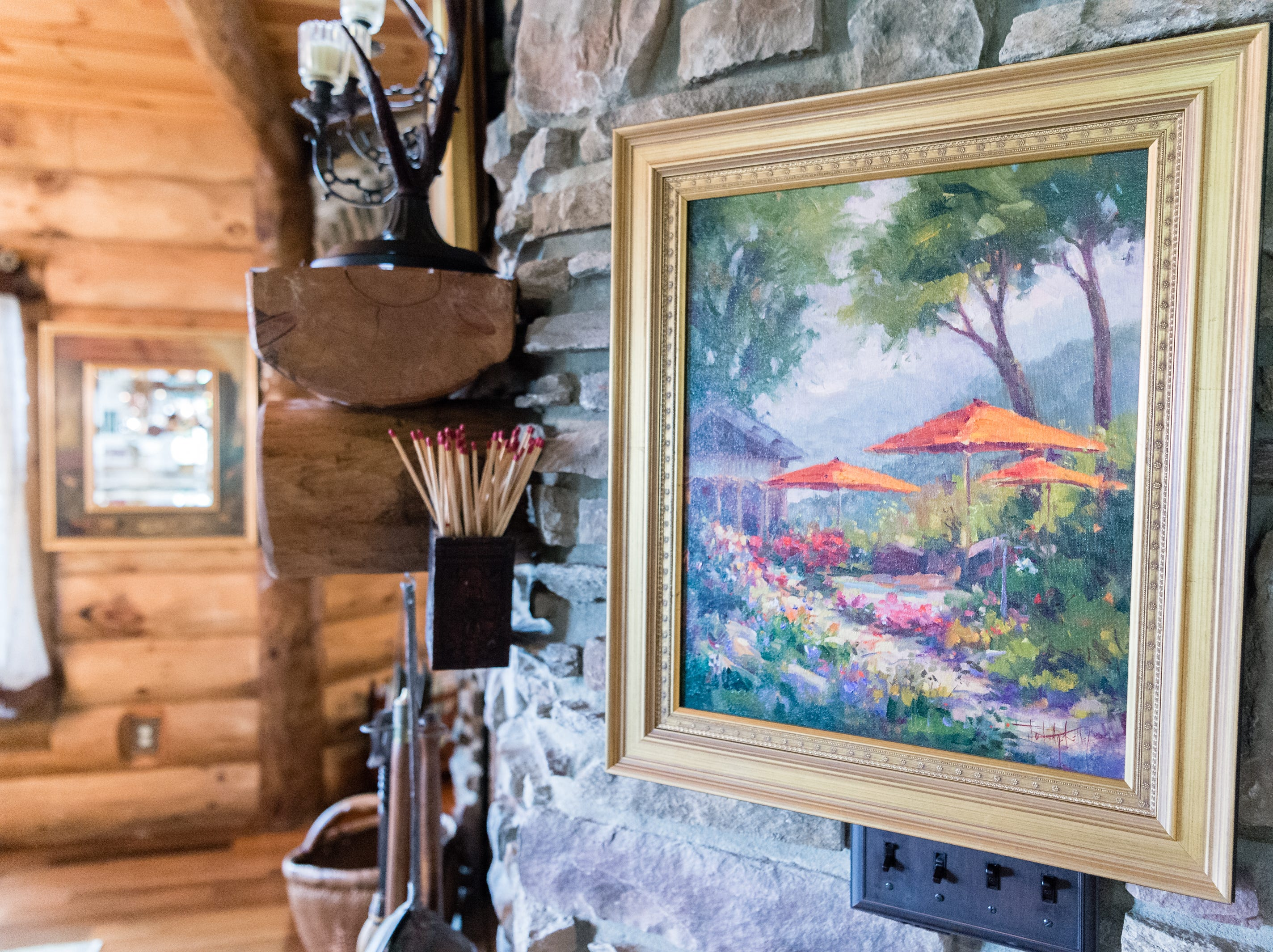 Artwork in the kitchen of Dan and Belle Fangmeyer's log cabin in Waynesville.