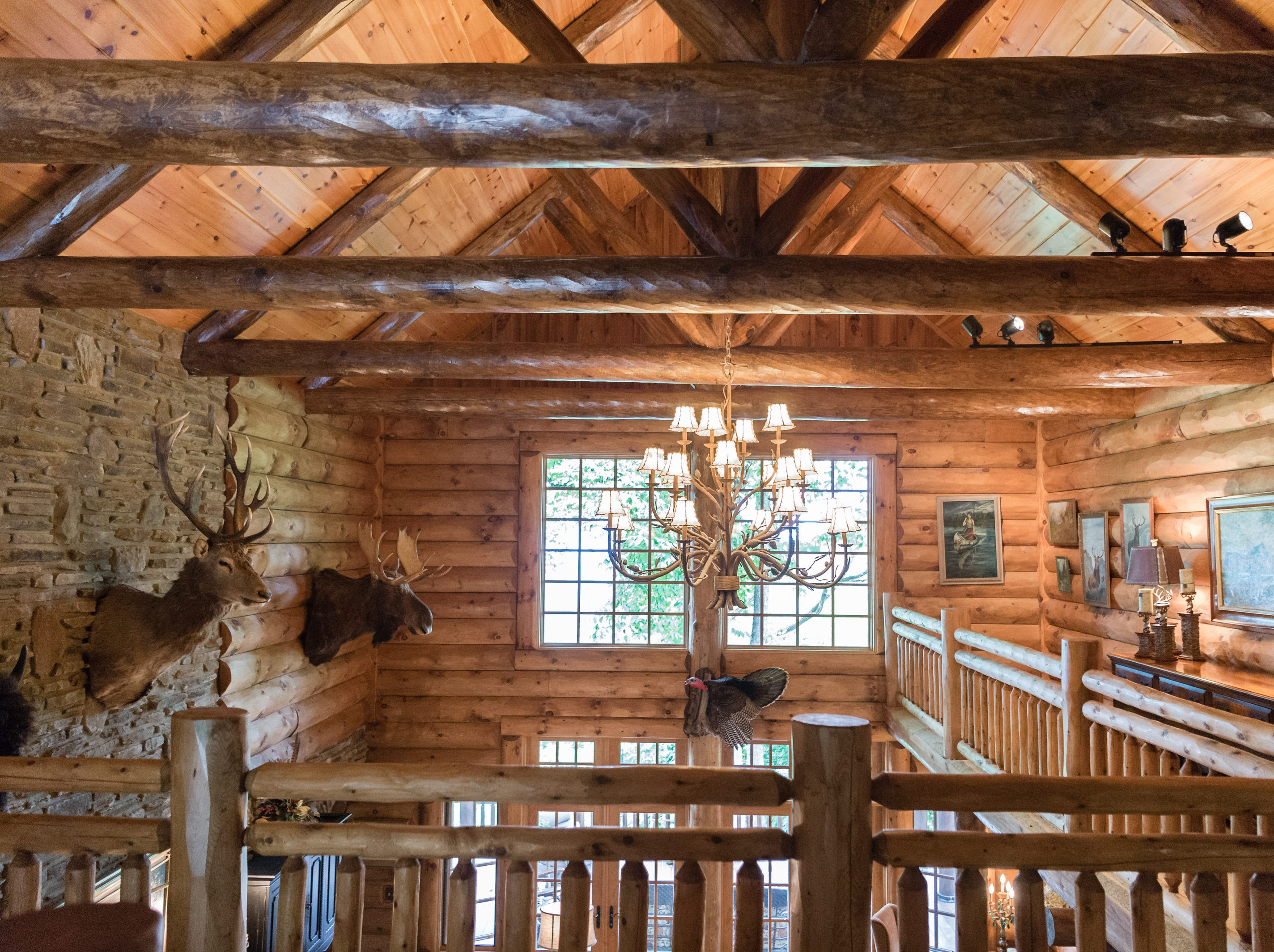 A balcony overlooking the great room in Dan and Belle Fangmeyer's log cabin in Waynesville.