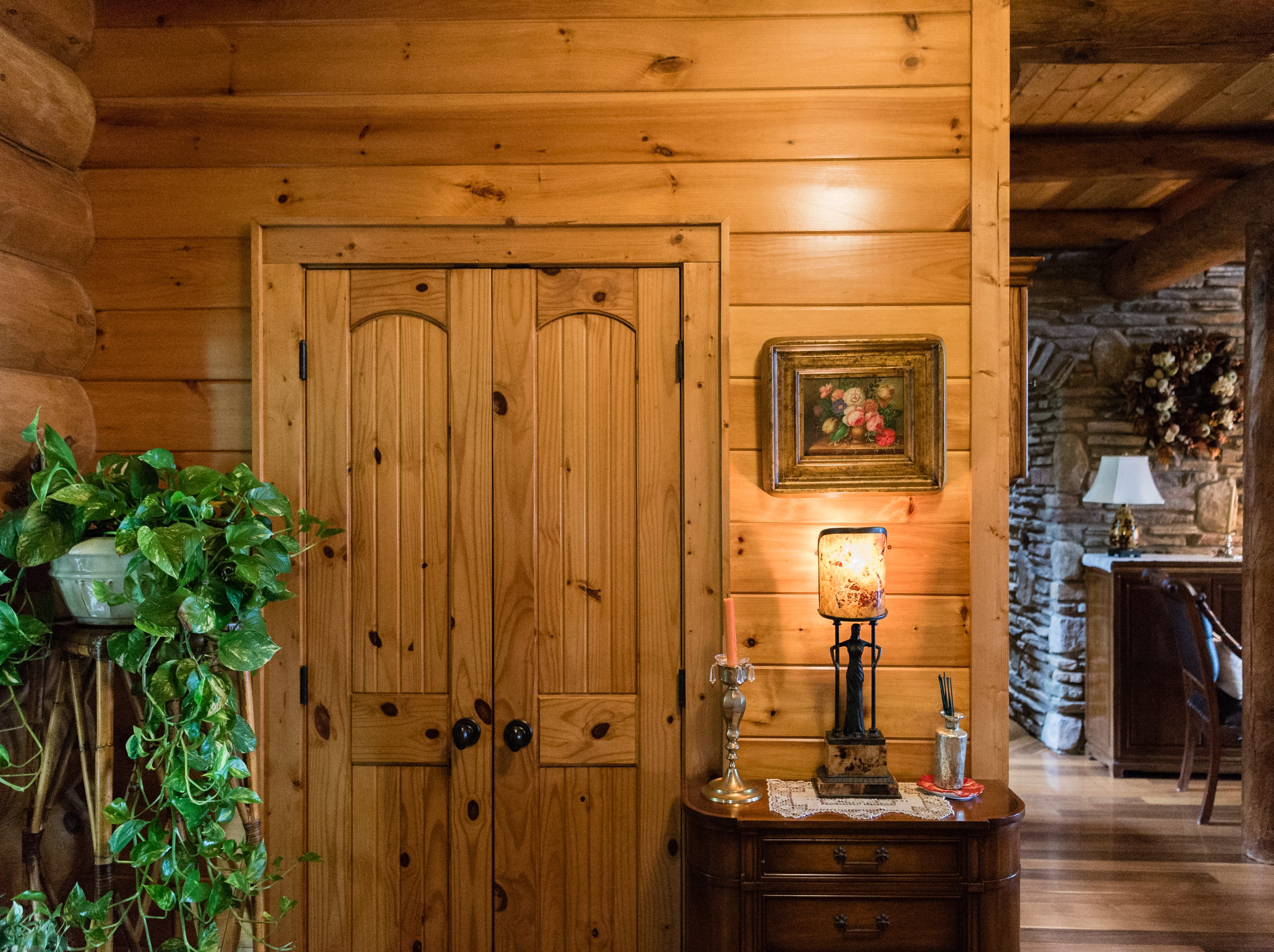 The foyer of Dan and Belle Fangmeyer's log cabin in Waynesville.