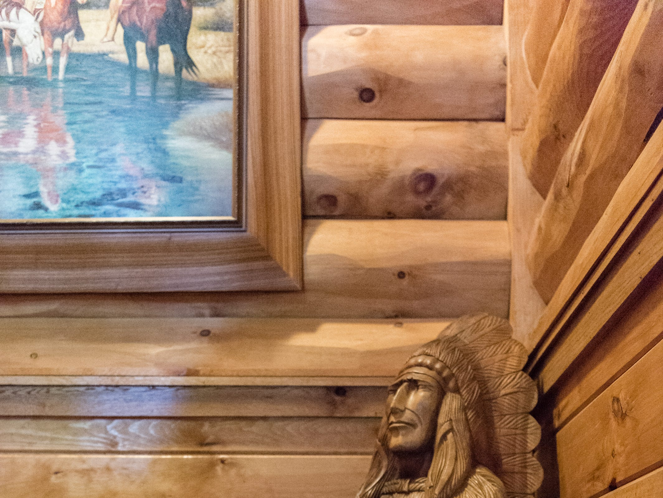 A wooden bust in the stairwell of Dan and Belle Fangmeyer's log cabin in Waynesville.