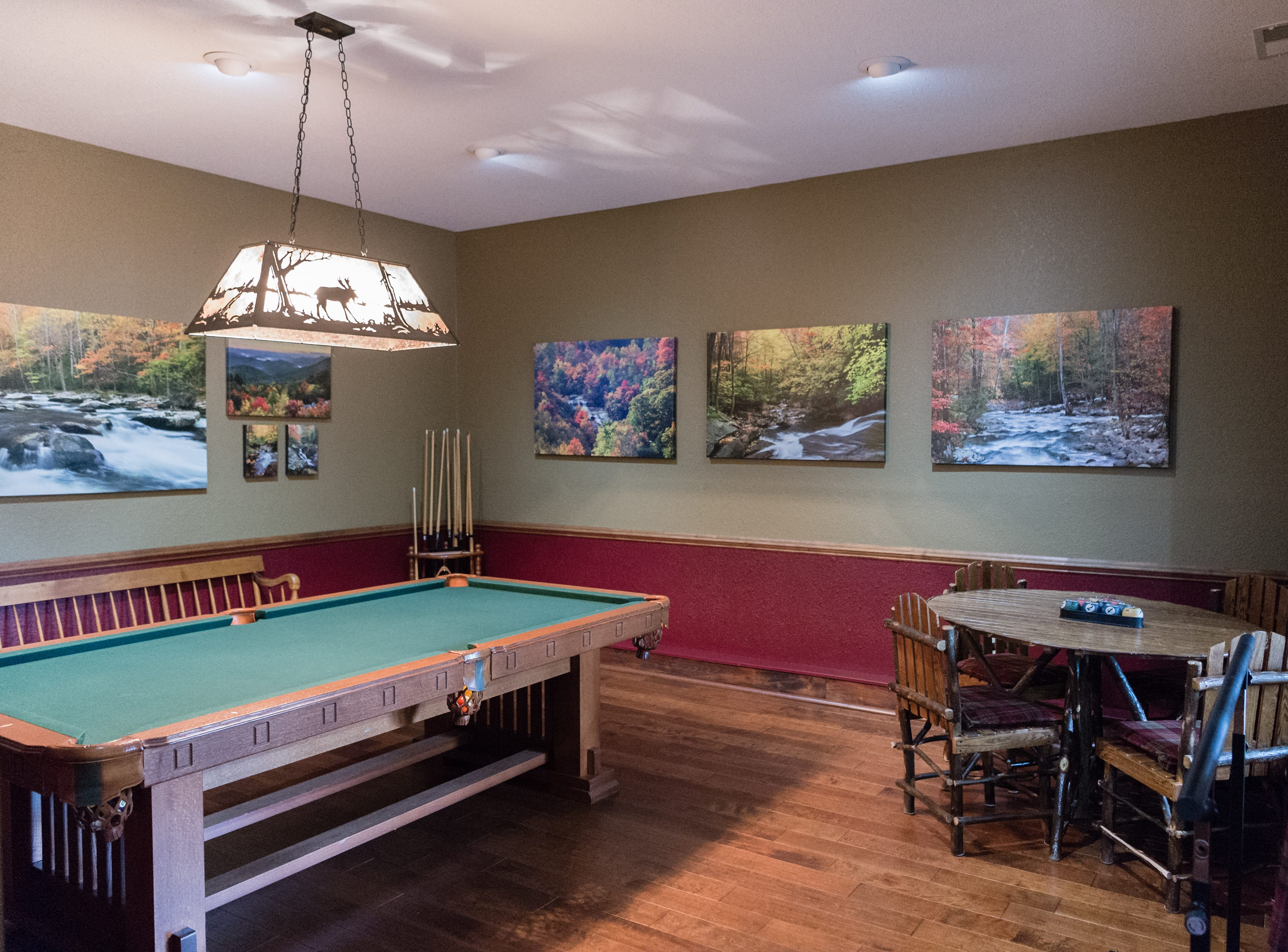 A game room on the basement level of Dan and Belle Fangmeyer's log cabin in Waynesville.