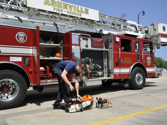Asheville Fire Fighter By Truck