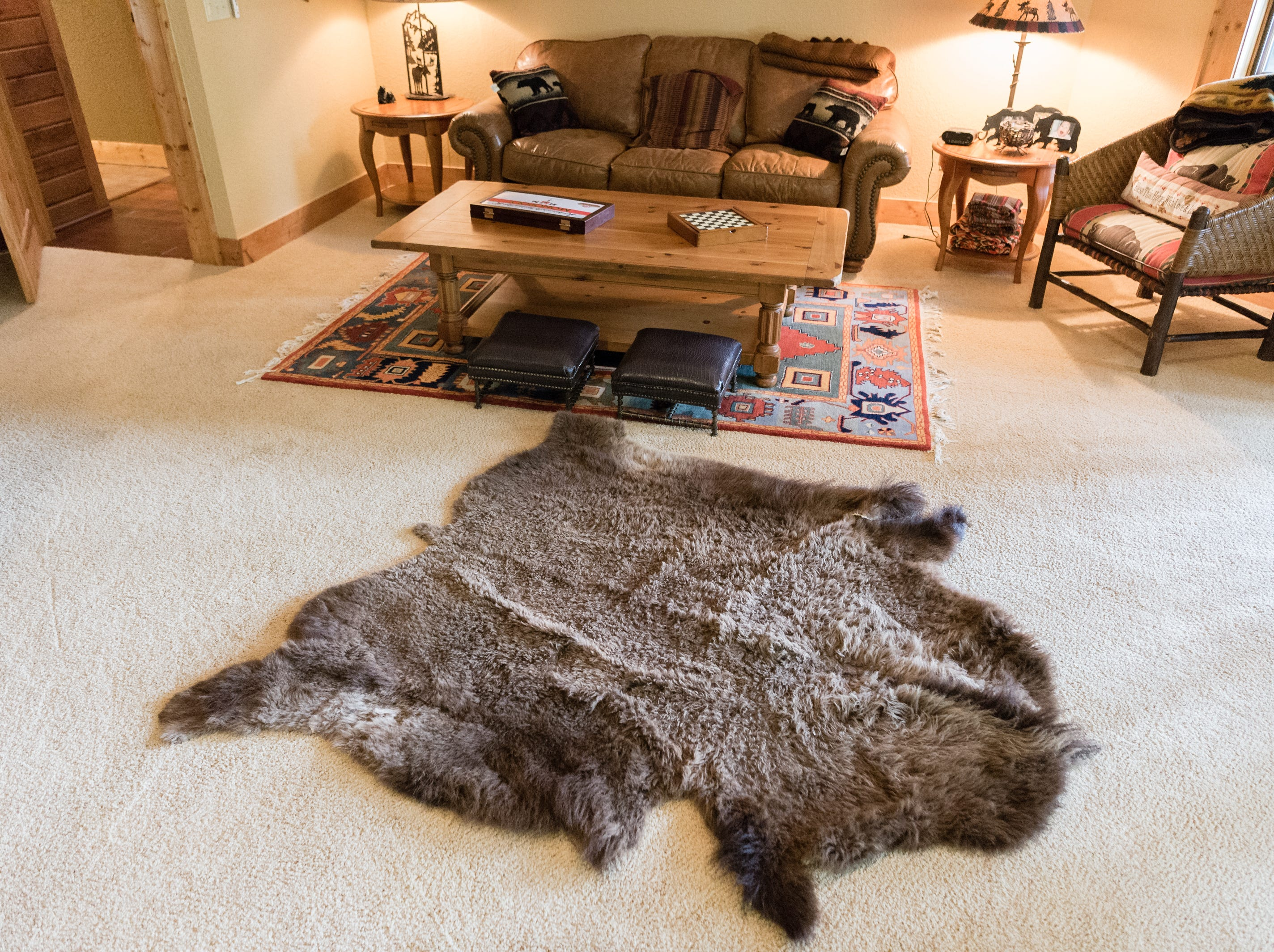 An animal hide in a room on the basement level of Dan and Belle Fangmeyer's log cabin in Waynesville.
