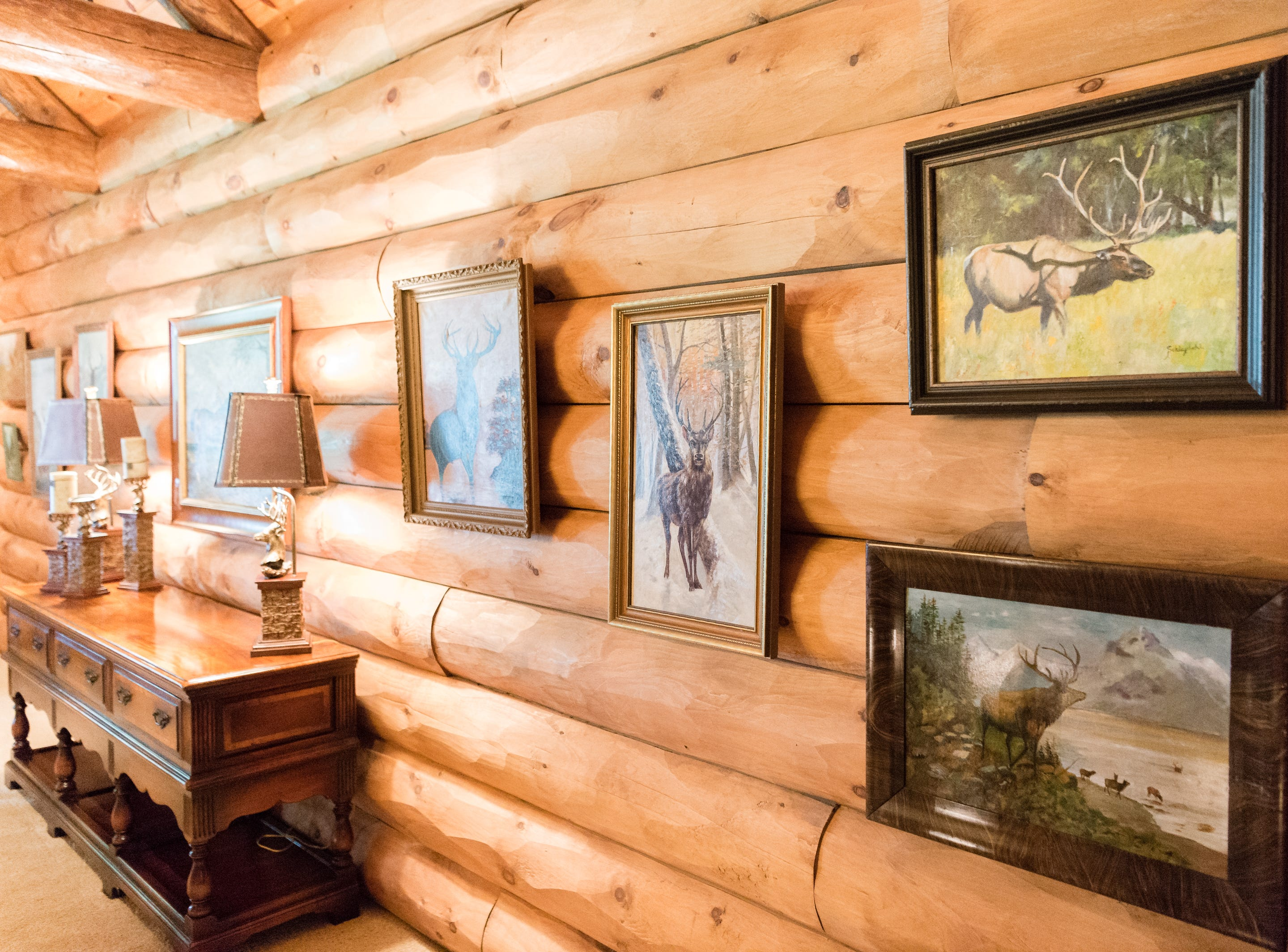 Artwork on the third floor of Dan and Belle Fangmeyer's log cabin in Waynesville.