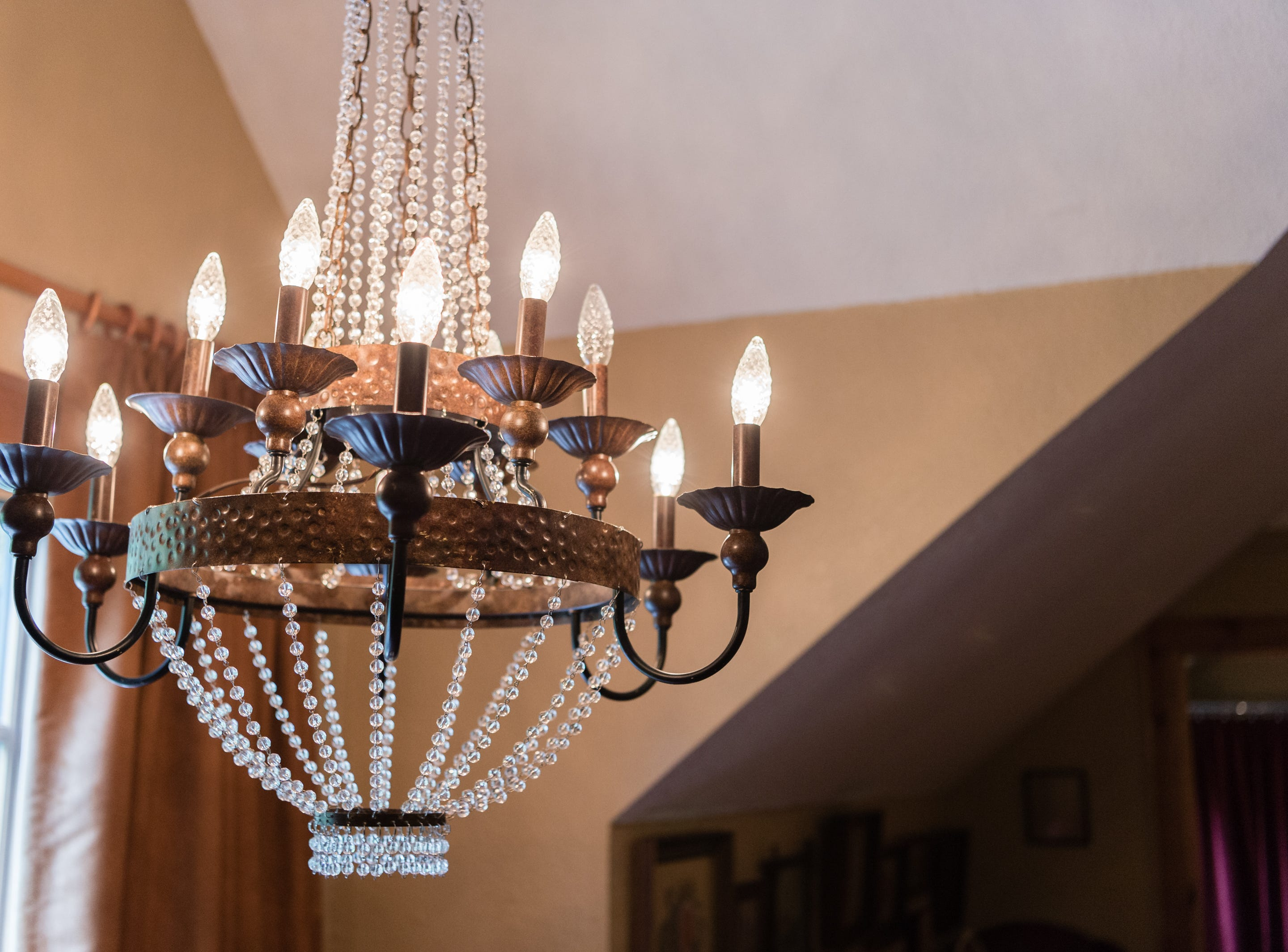 A chandelier in a bedroom on the third floor of Dan and Belle Fangmeyer's log cabin in Waynesville.