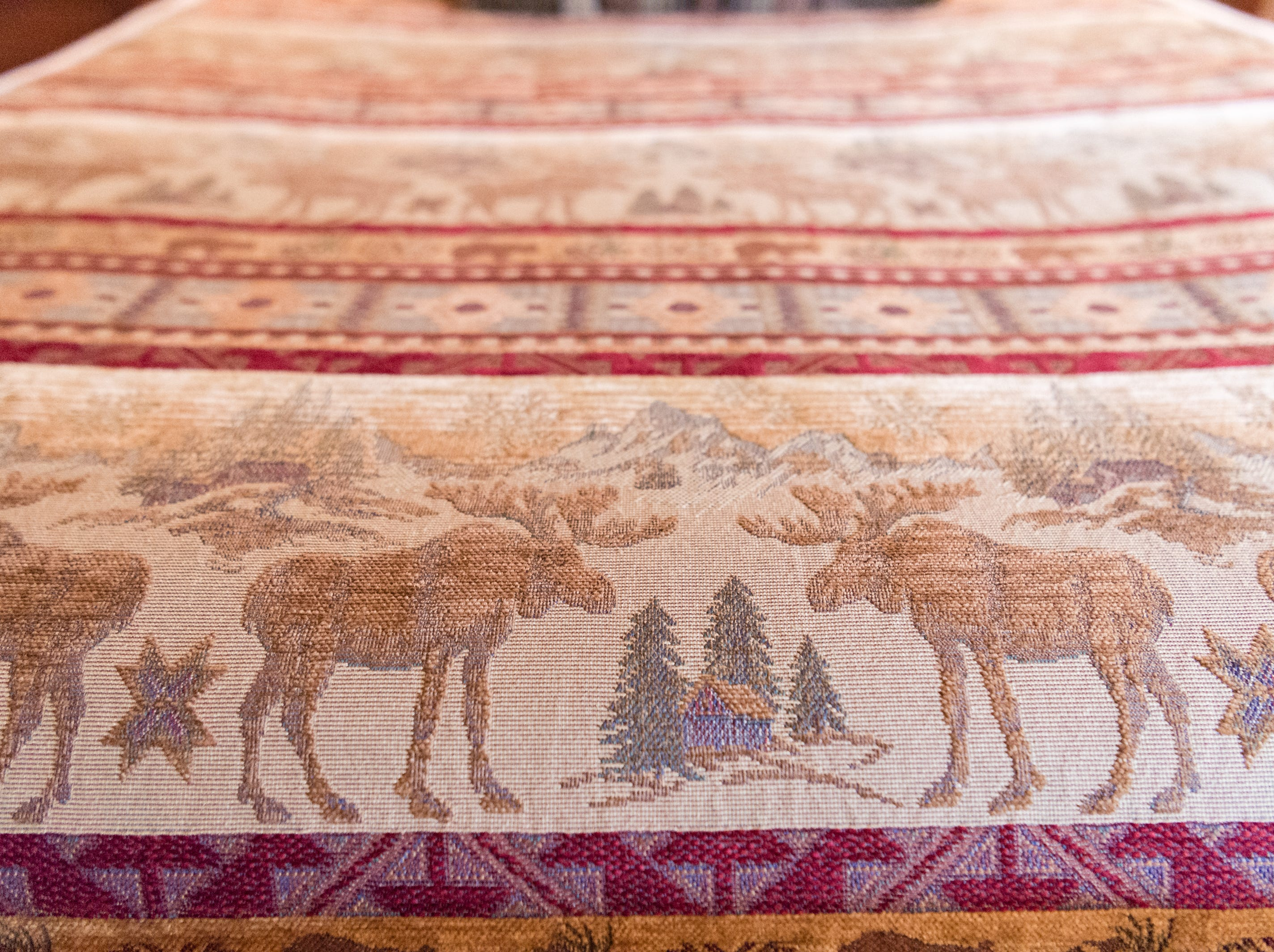 A comforter with a moose motif in a bedroom on the third floor of Dan and Belle Fangmeyer's log cabin in Waynesville.