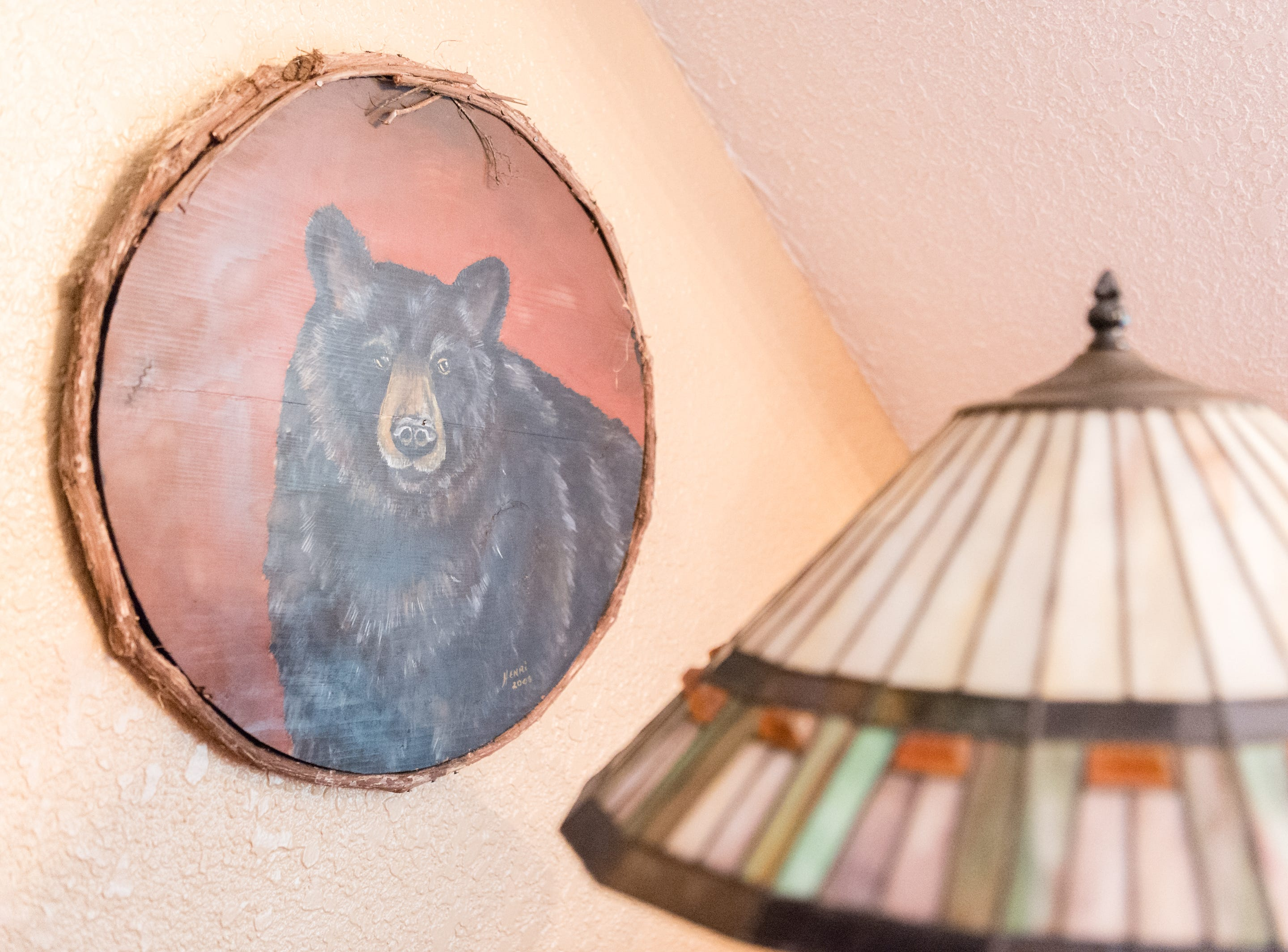 Artwork in a bedroom on the third floor of Dan and Belle Fangmeyer's log cabin in Waynesville.