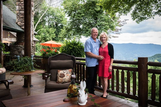 Dan and Belle Fangmeyer on the deck of their log cabin in Waynesville.