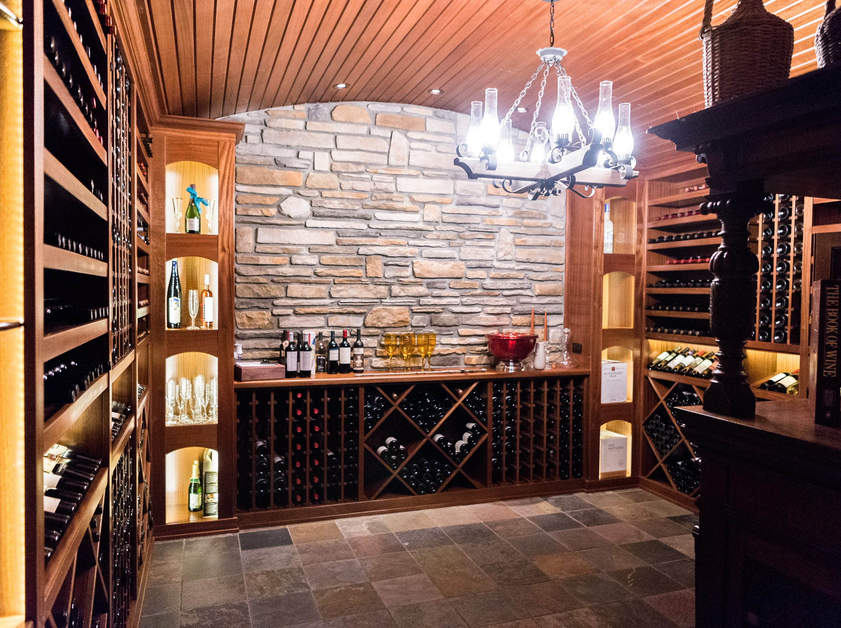 A wine cellar on the basement level of Dan and Belle Fangmeyer's log cabin in Waynesville.