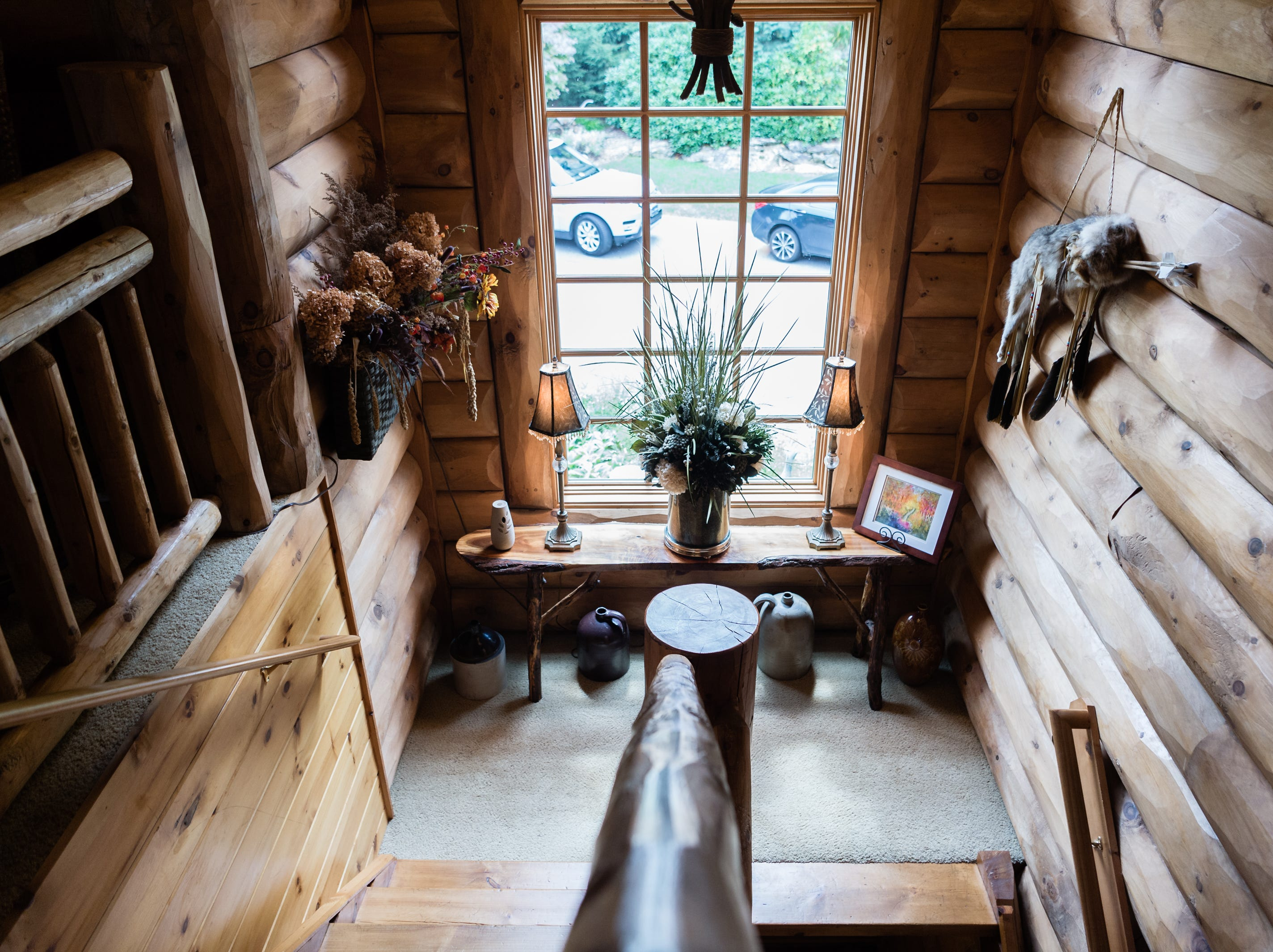 A stairwell in Dan and Belle Fangmeyer's log cabin in Waynesville.