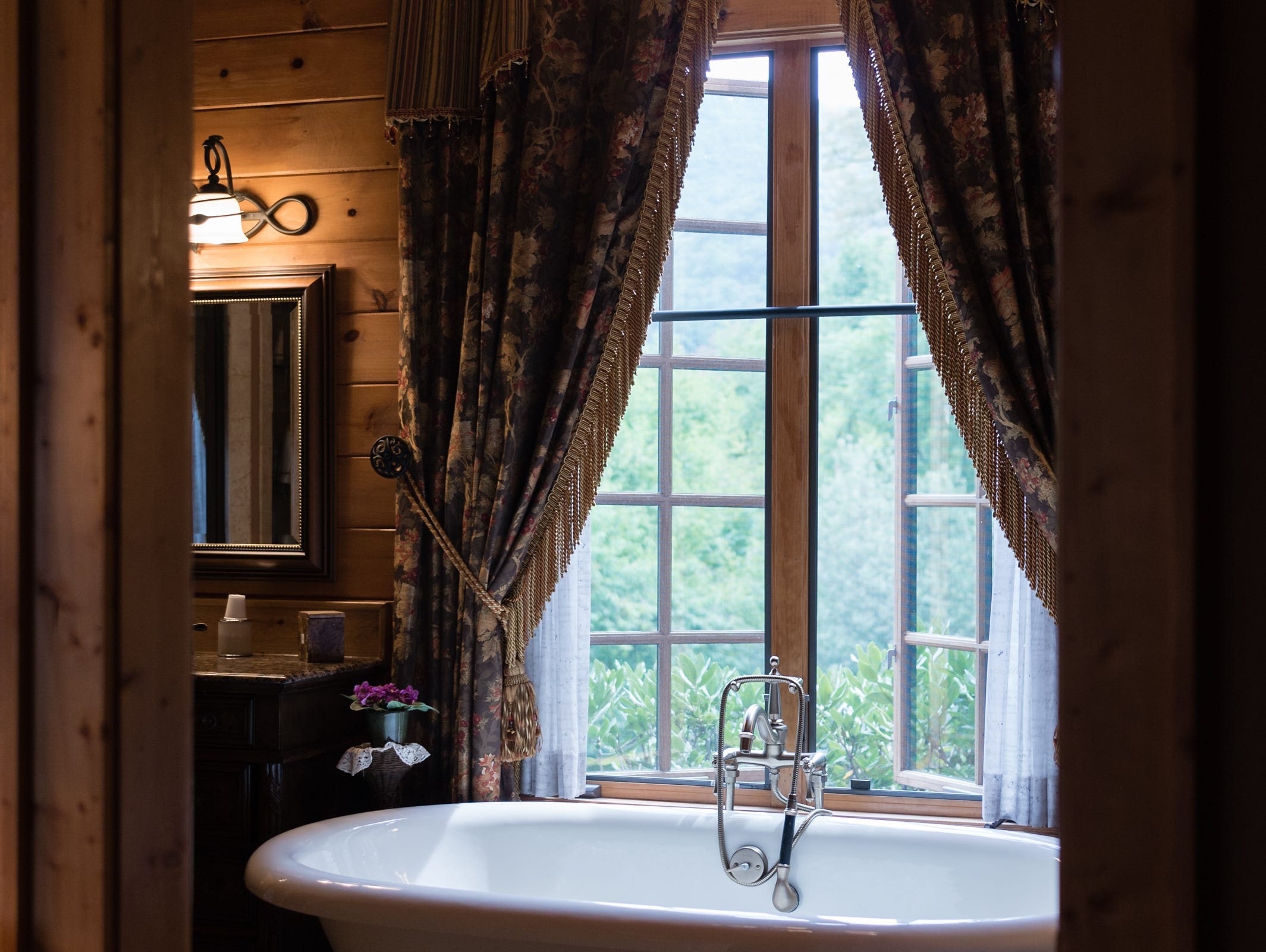 The master bathroom of Dan and Belle Fangmeyer's log cabin in Waynesville.