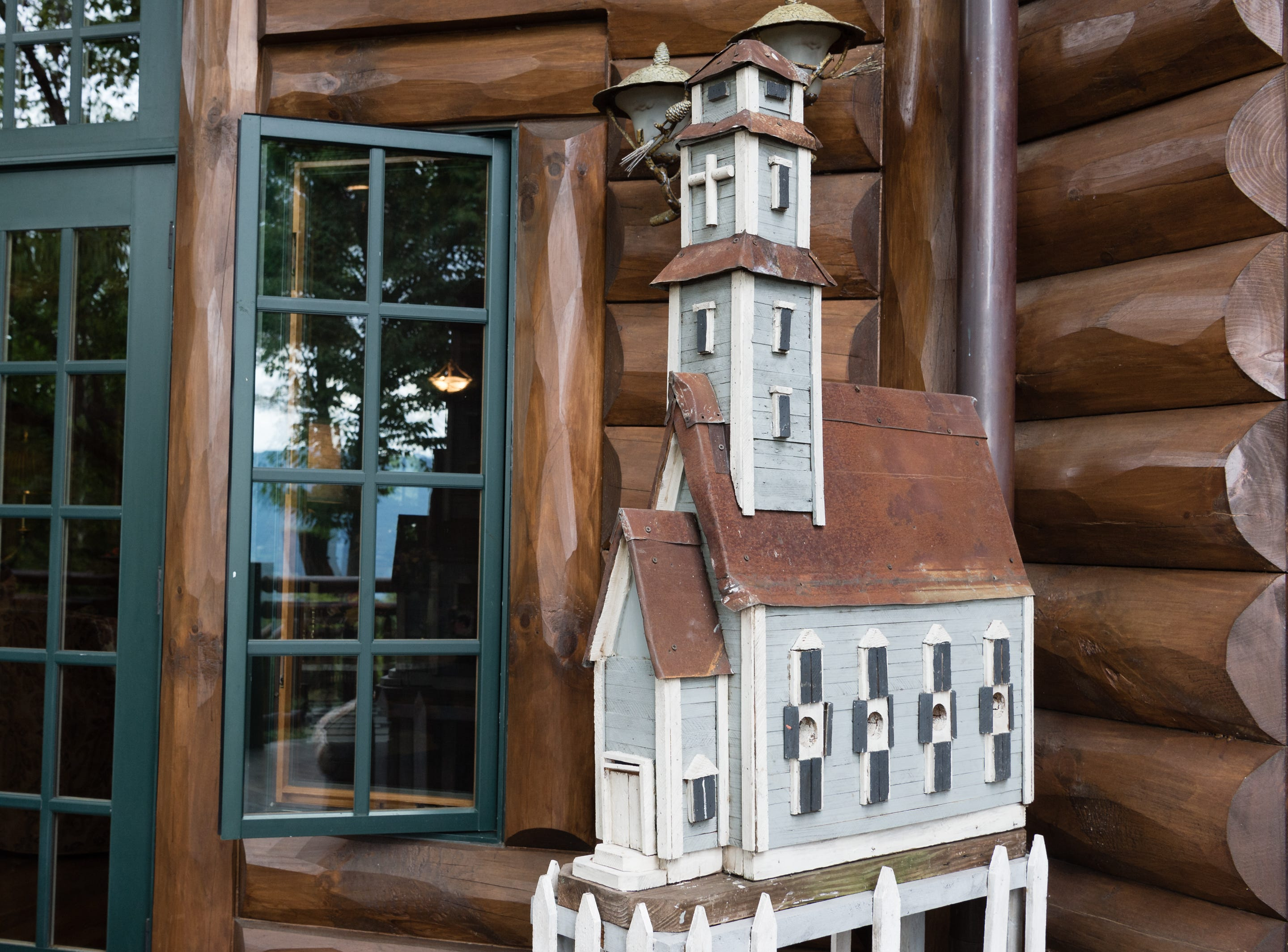 A wooden miniature church on the deck of Dan and Belle Fangmeyer's log cabin in Waynesville.
