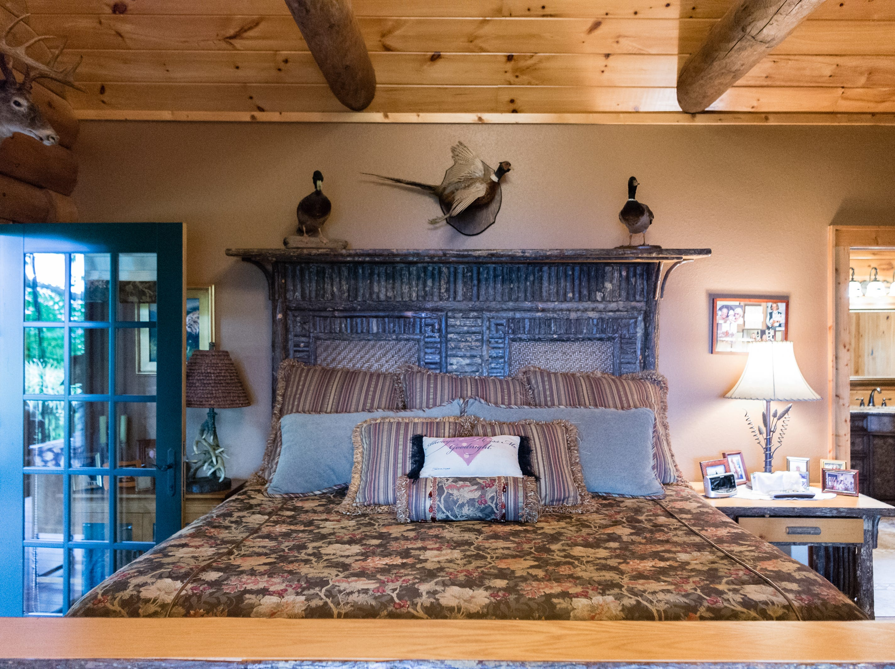 The master bedroom in the home of Dan and Belle Fangmeyer's log cabin in Waynesville.