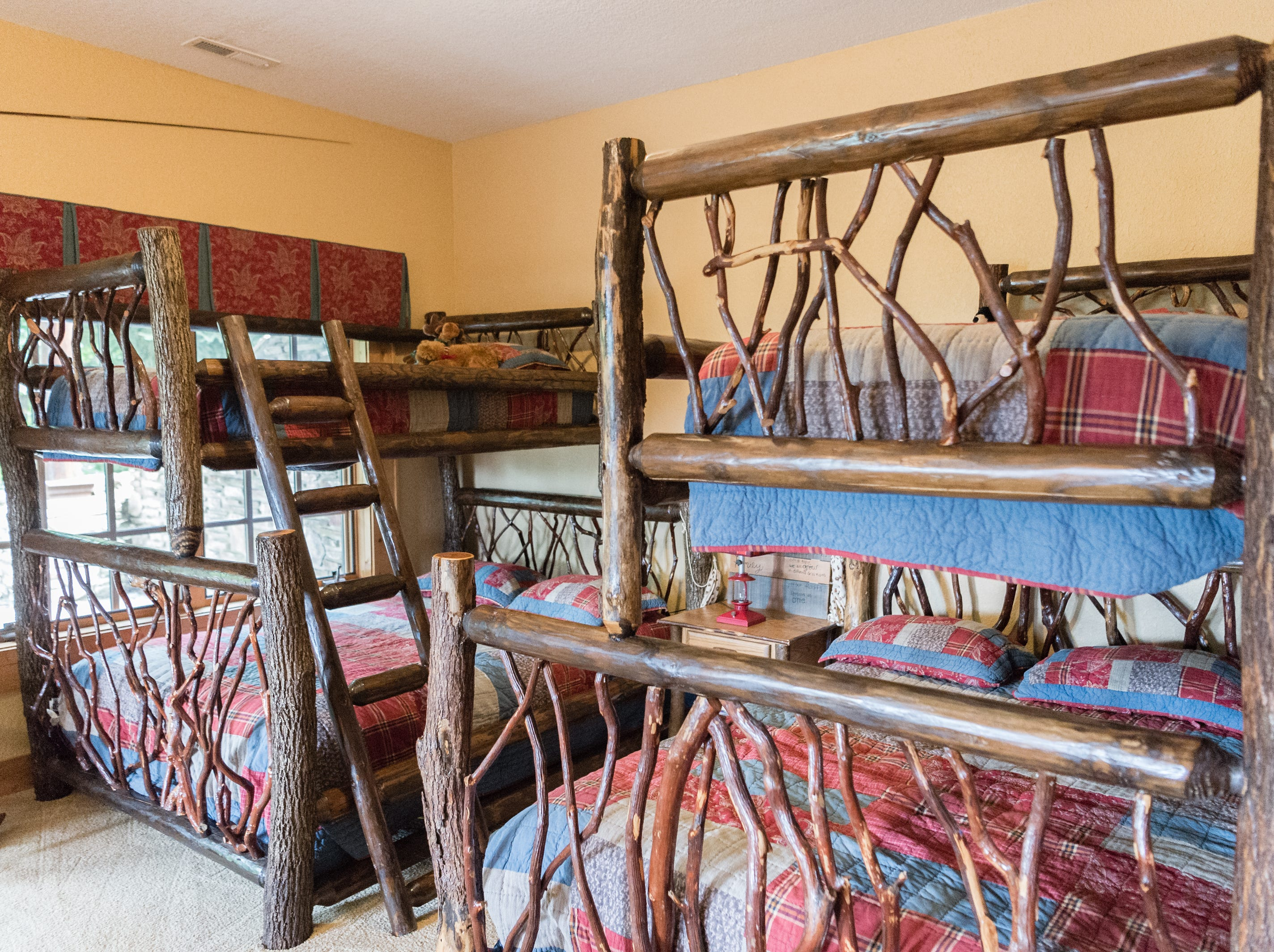 Bunk beds in a room on the basement level of Dan and Belle Fangmeyer's log cabin in Waynesville.