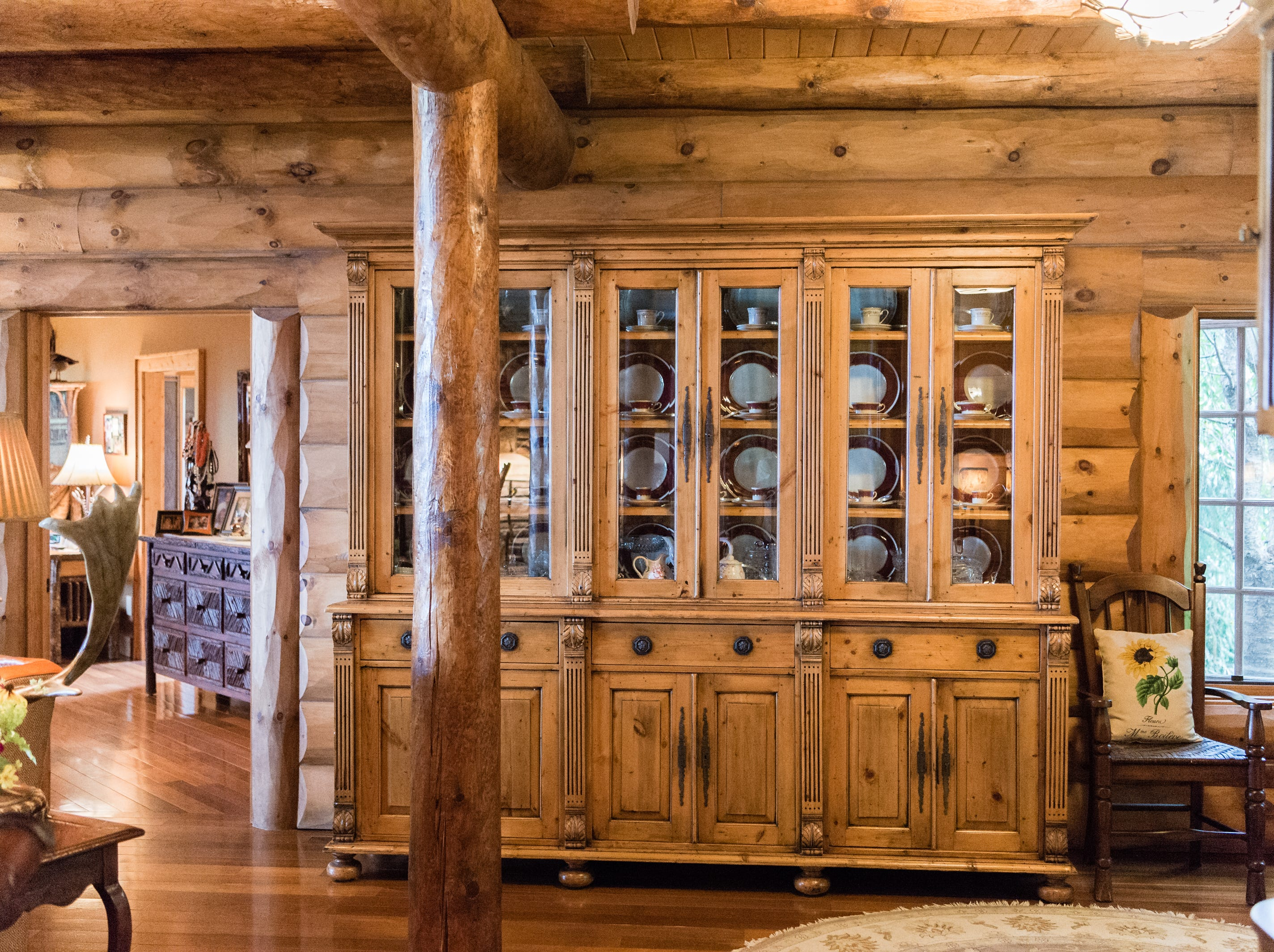 A large cabinet in the entryway of Dan and Belle Fangmeyer's log cabin in Waynesville.