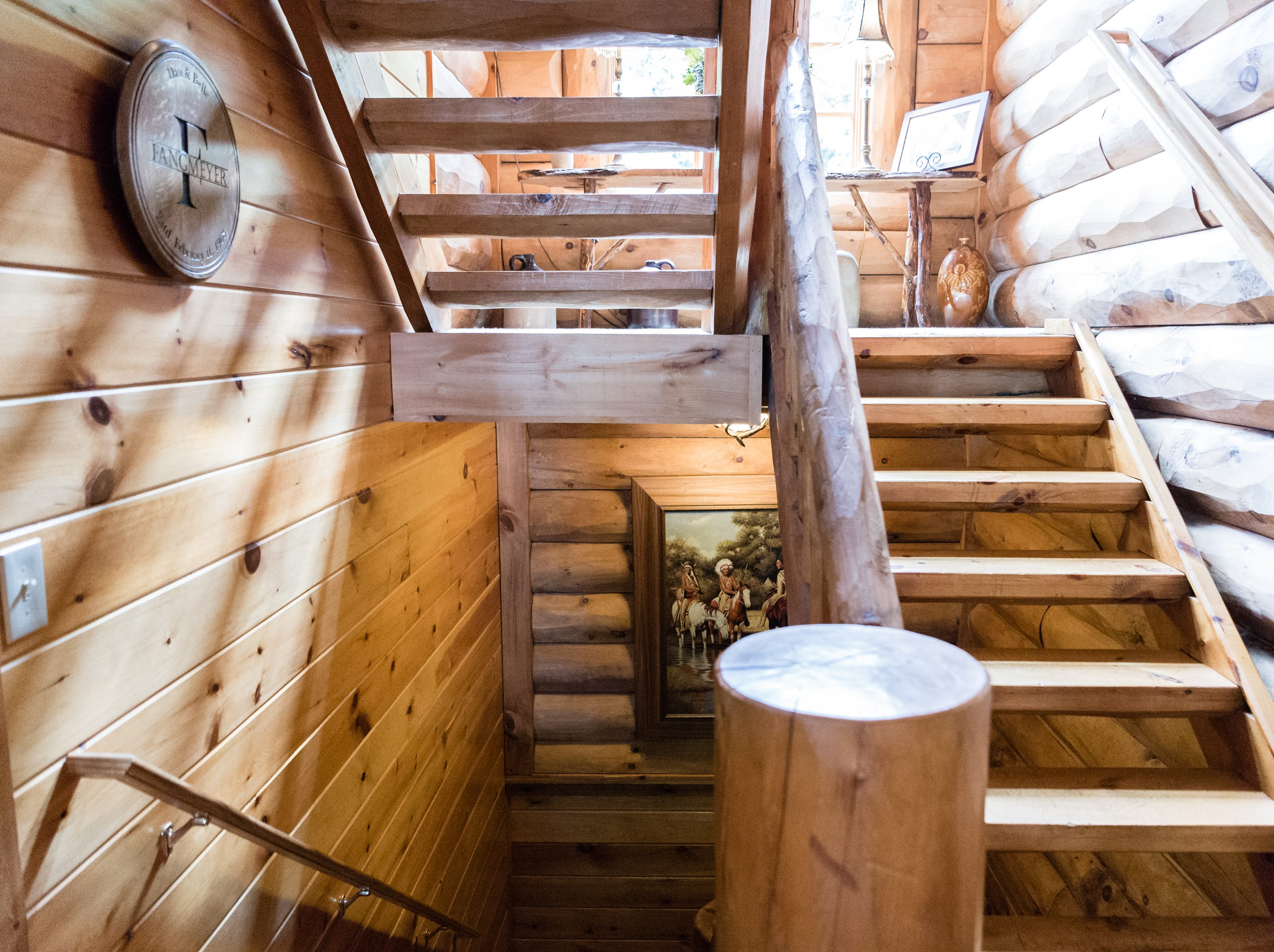 A stairway on the main level of Dan and Belle Fangmeyer's log cabin in Waynesville.
