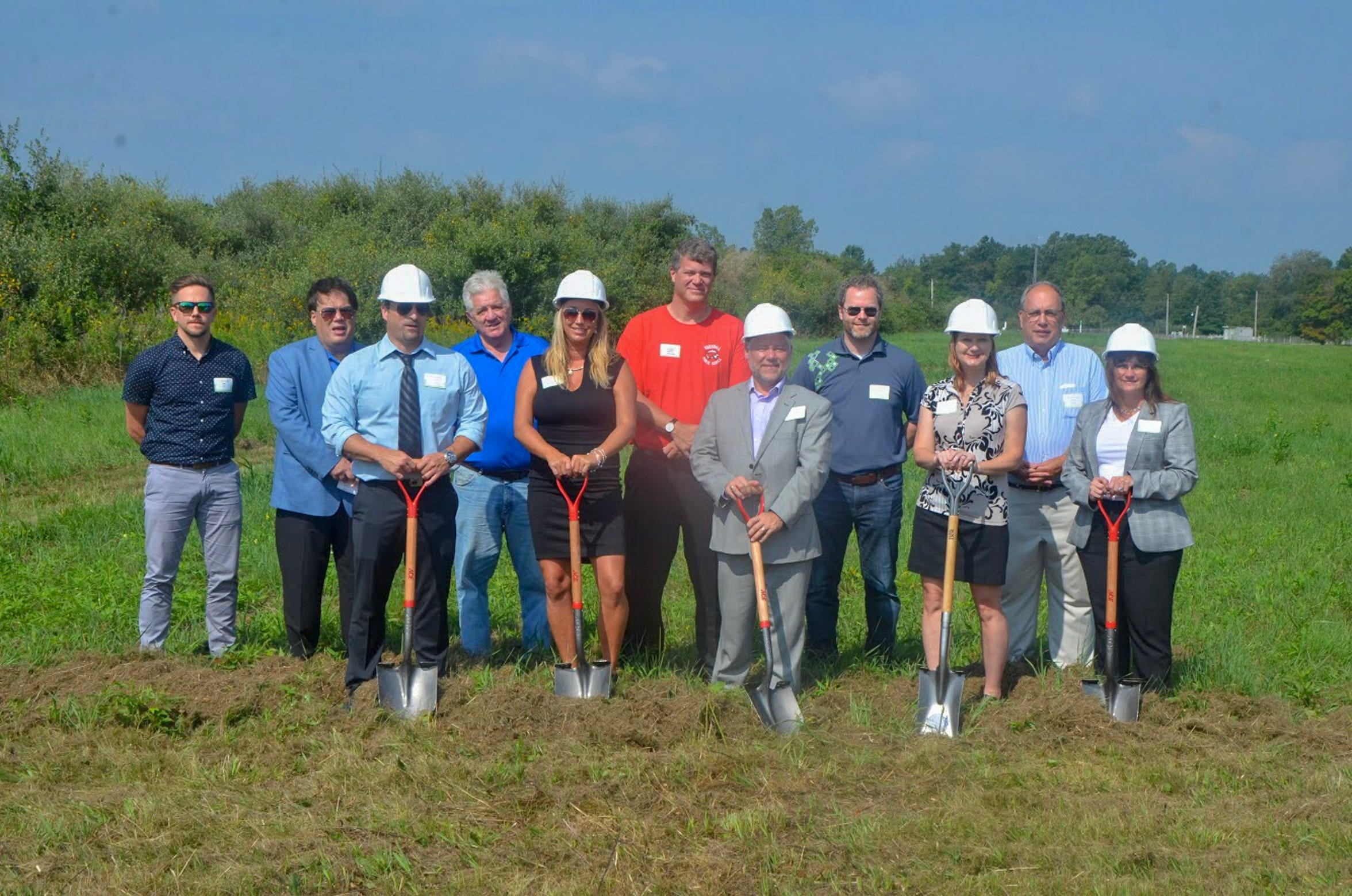 Representatives from Green Eden, a new medical marijuana growing facility in Marshall, pose alongside representatives from the city of Marshall at Green Eden's groundbreaking on Aug. 27, 2018, at 16500 Division Dr., Marshall, MI.