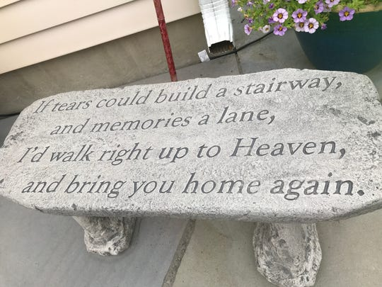 Debbie Zeitz keeps this bench at her Johnson City home in honor of her mother, Gloria, who died in 2017.