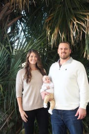John Fullington with his wife, Amanda, and their daughter Ellie Lois.