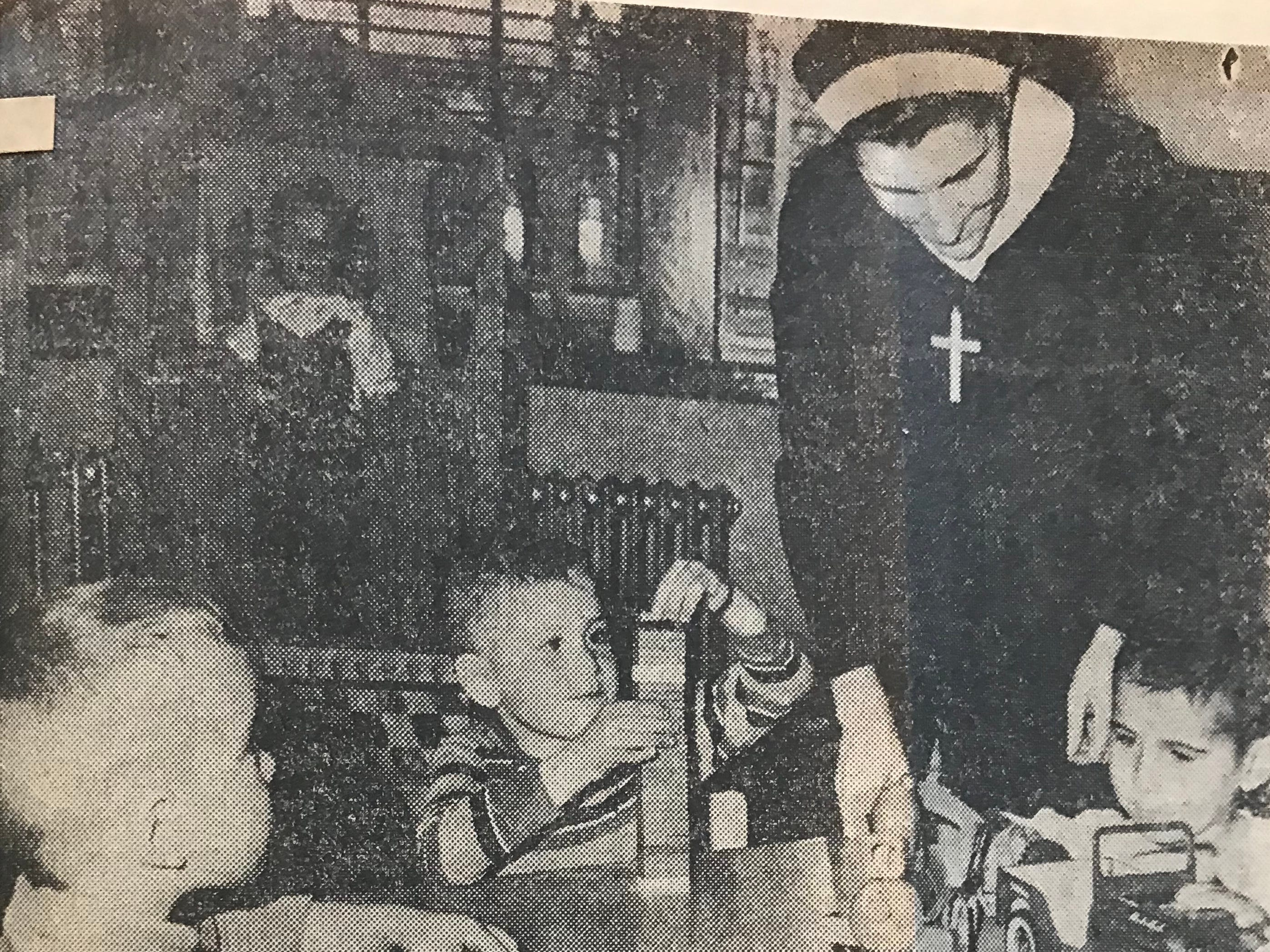 """This Burlington Free Press clipping from December 1966 shows a nun listed as """"Sister Donat"""" with children at St. Joseph's Orphanage."""