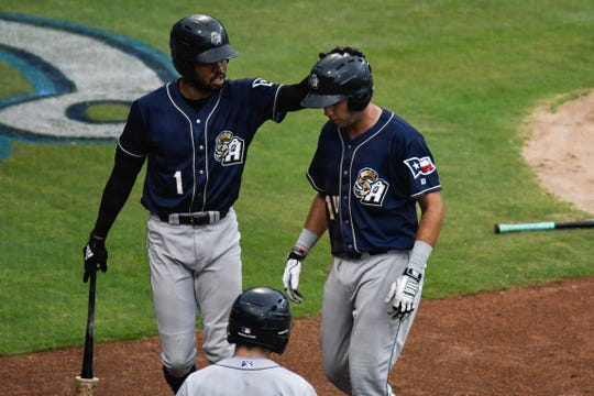 San Antonio Missions outfielder Buddy Reed congratulates Hudson Potts against the Hooks on Sunday, Sept. 9, 2018 at Whataburger Field in Corpus Christi, Texas.