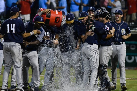 San Antonio Missions players celebrate after beating the Hooks in Game 5 of a Texas League playoff series on Sunday, September 9, 2018 at Whataburger Field in Corpus Christi, Texas.