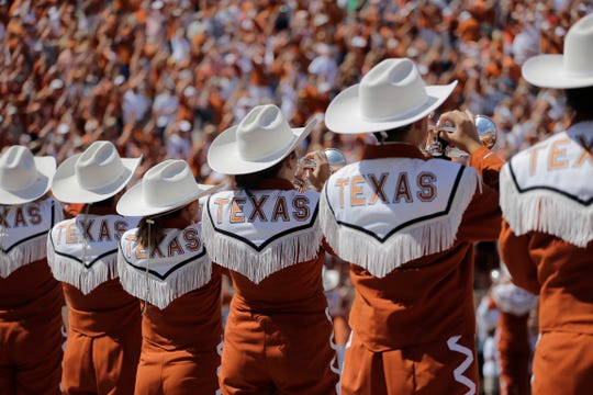 Texas band members perform before an NCAA college football game against Oklahoma State, Saturday, Sept. 26, 2015, in Austin, Texas. (AP Photo/Eric Gay)